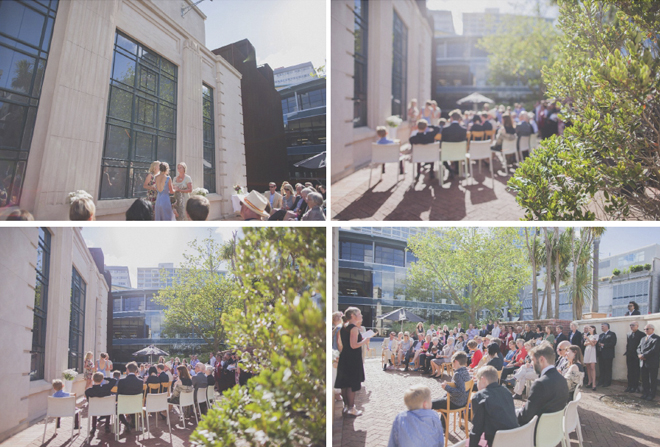 Non traditional Wedding ceremony in bright sunshine, in Wellington Civic square, with the old library building as a backdrop.