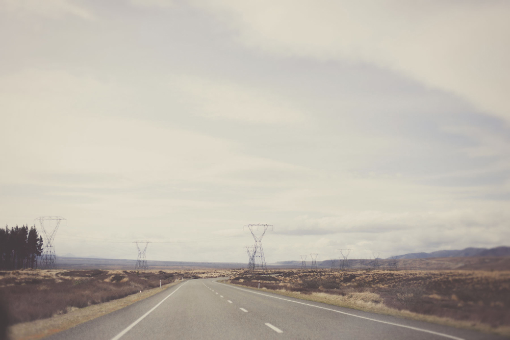 Landscape Desert road in New Zealand, with pylons.