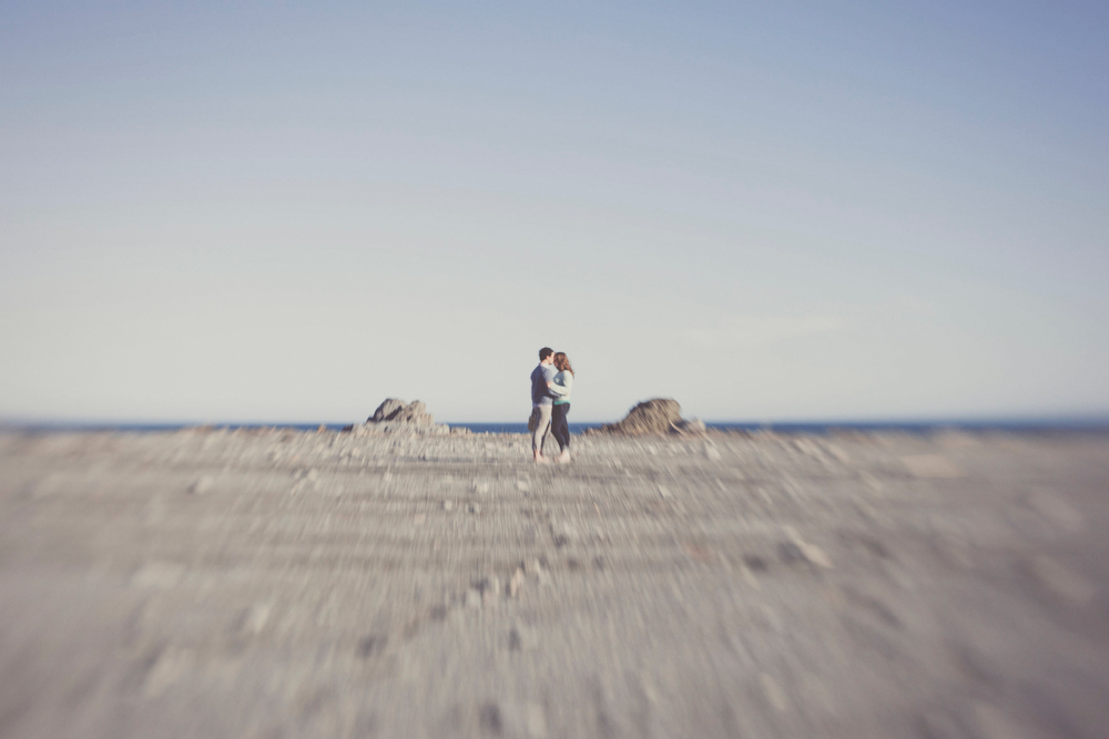 Rugged desolate sea/ landscape with couple in the middle. By jenny Siaosi.