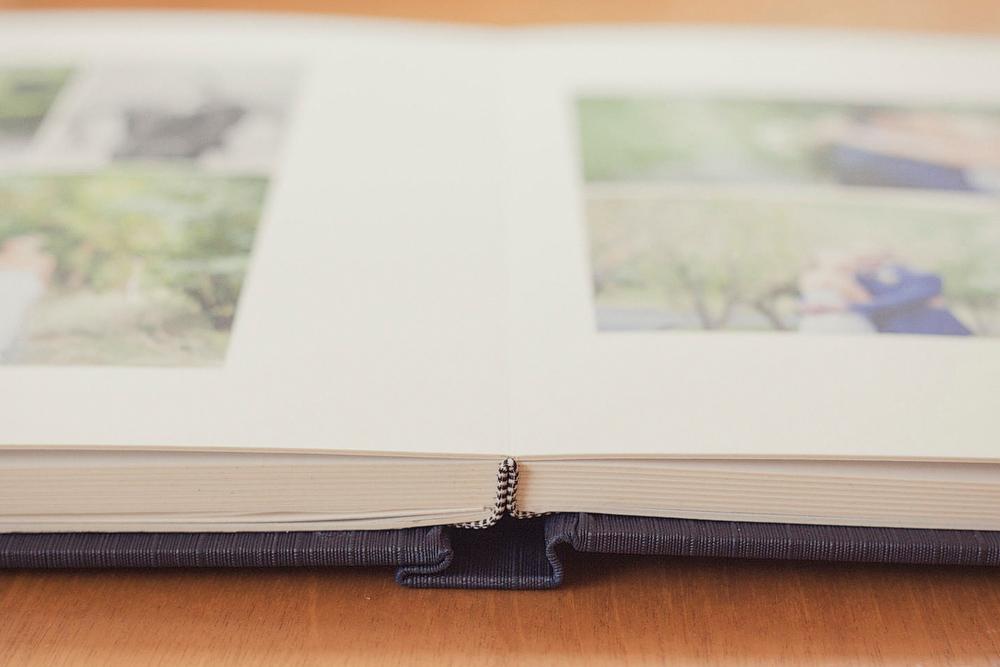 Lay flat fine art wedding album detail photo.