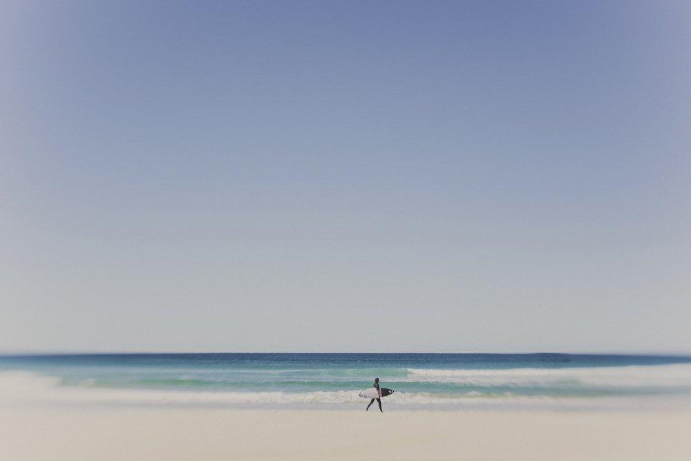 Classic Australia image of surfer on beach, using the lensbaby. Photos of holiday in the Sunshine Coast. Australia.