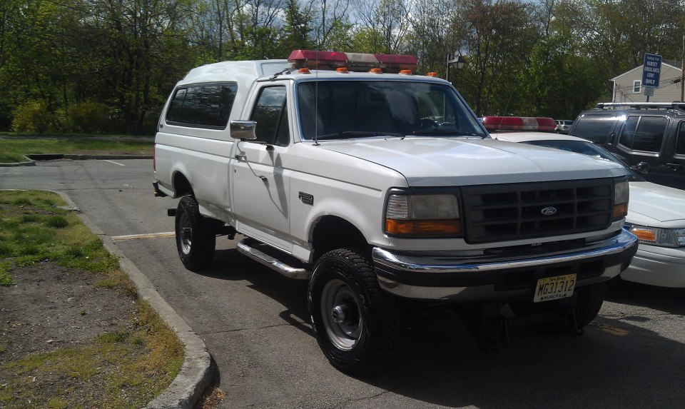 Special Operations Unit 418: 1997 Ford F-350. Retired Ramsey DPW pick-up truck used for scenes requiring the utilization of the Field Treatment Unit or EMS Bike Unit. Primary vehicle used to tow LSU-1.  White paint job donated by King Crash Auto Collision of Ramsey.