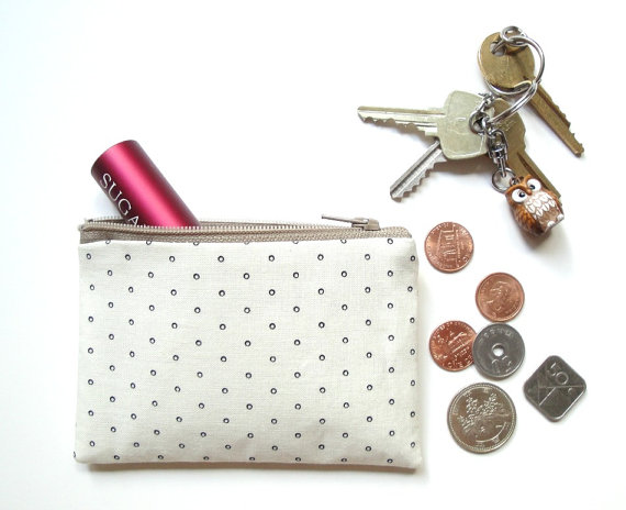 a small  pouch  for those little things, like lip glass, coins, and face spray (a must for flying)