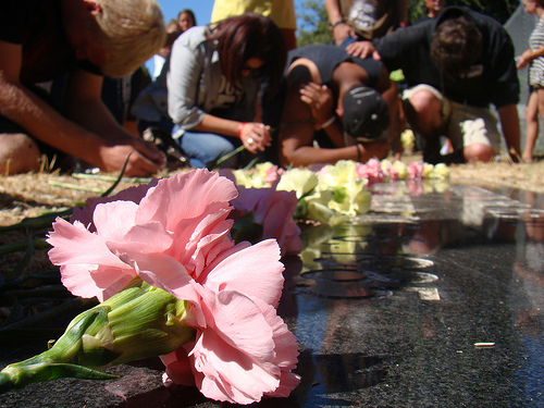 Survivors pray before the grave-site of thousands of aborted babies in a previous memorial in Los Angeles County, CA