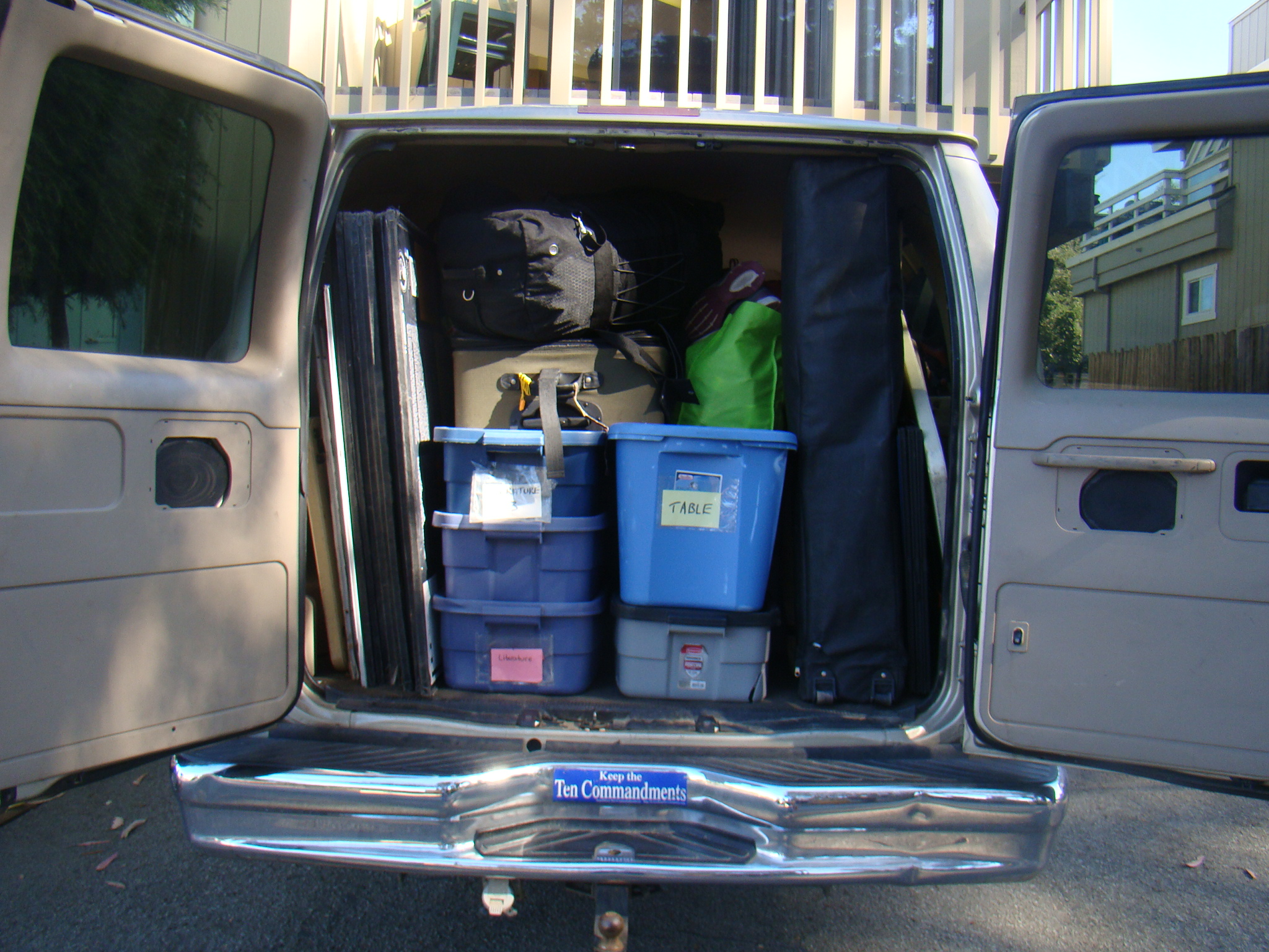A very-packed packed  gold van just prior to early AM departure