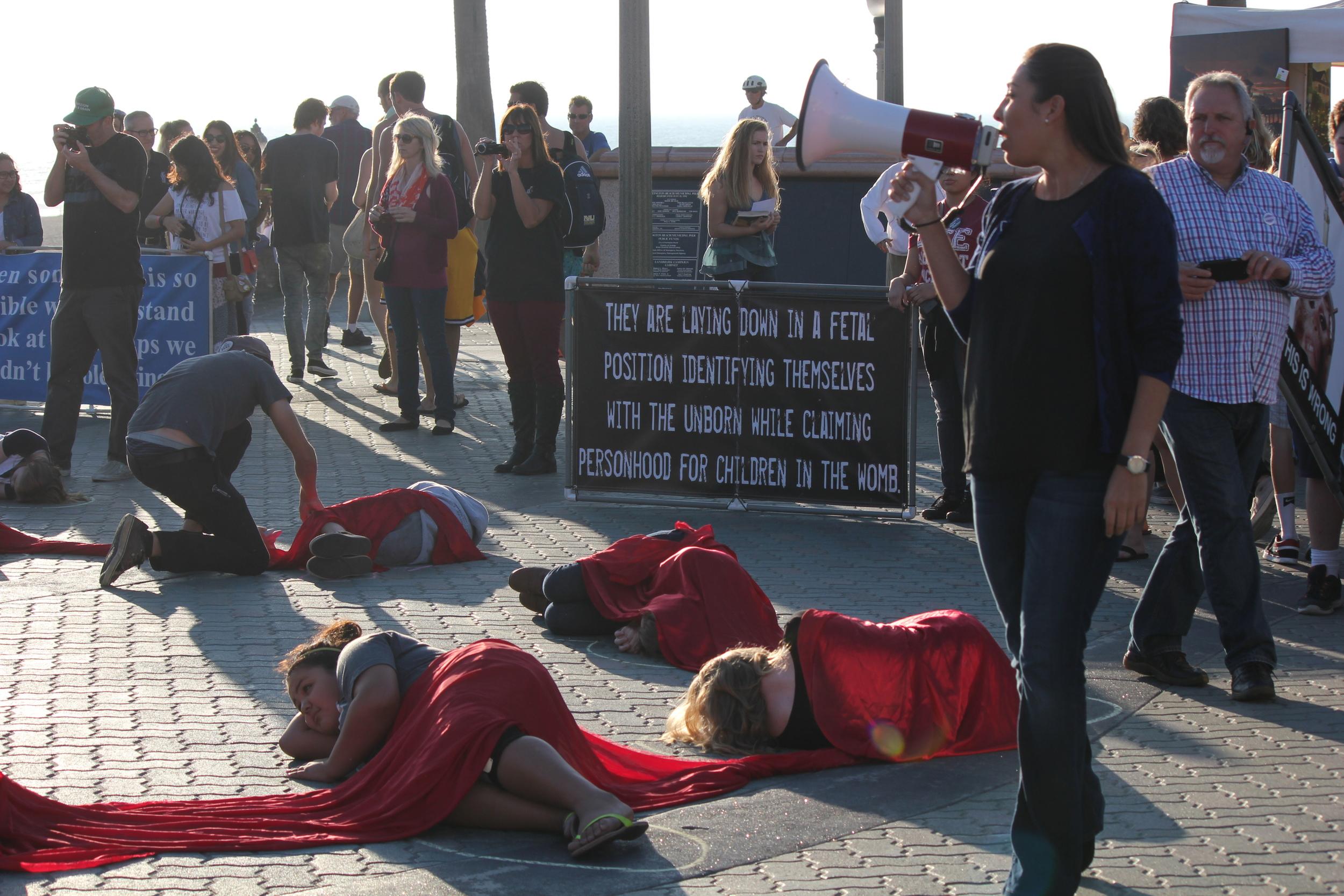 Million-to-one memorial die-in at Huntington Beach