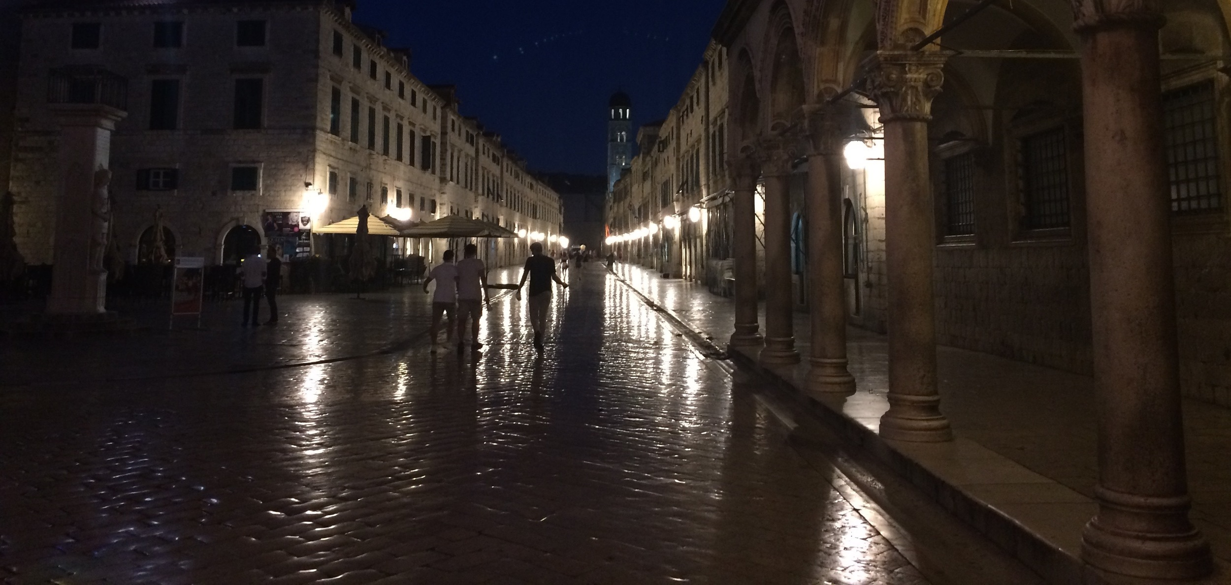 Dubrovnik's main street, Stradun, at 5:00 AM when all is quiet. The surface is not wet, it is highly polished from centuries of foot travel.