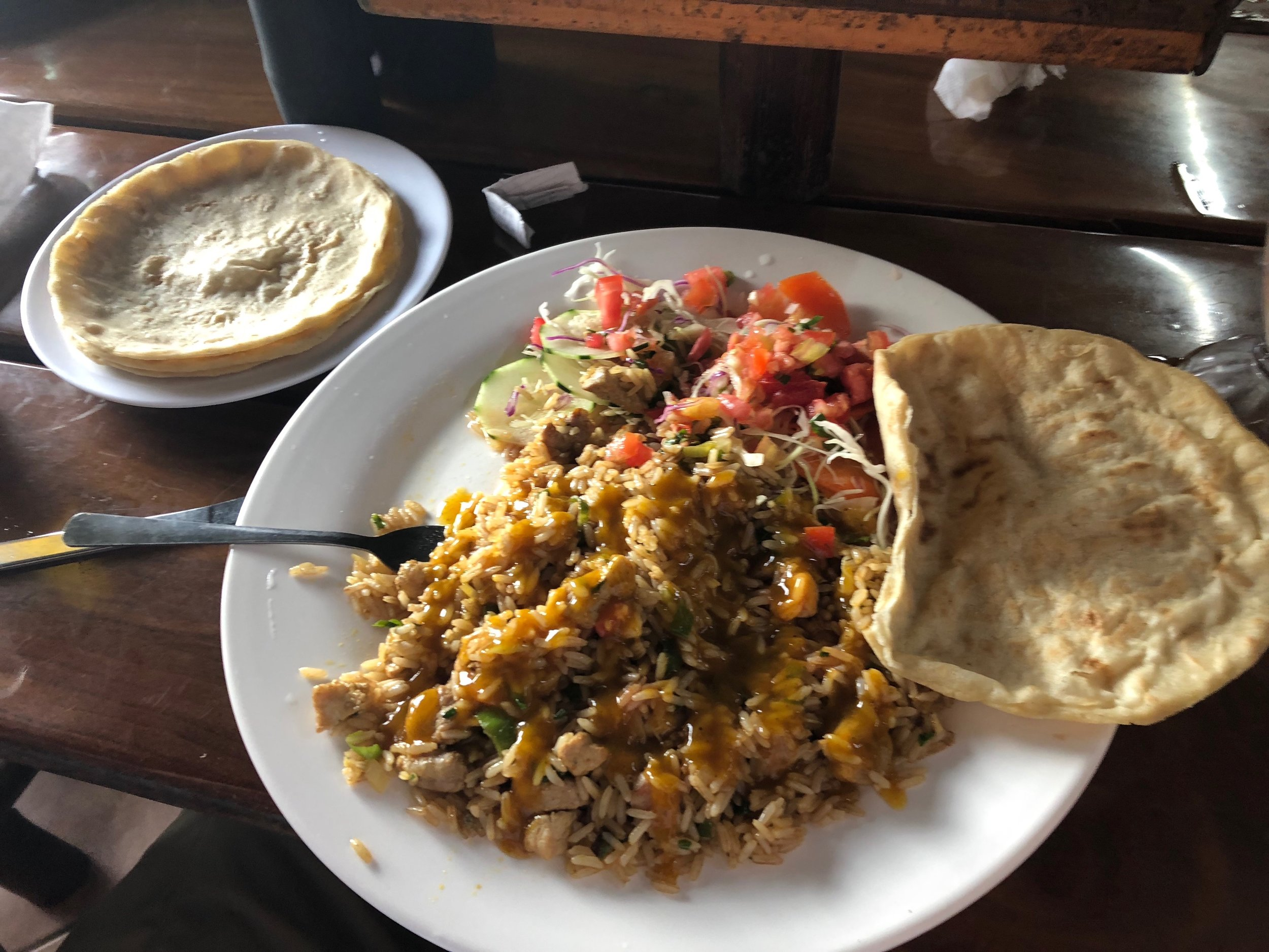 Rice with chicken and hand made corn tortilla.
