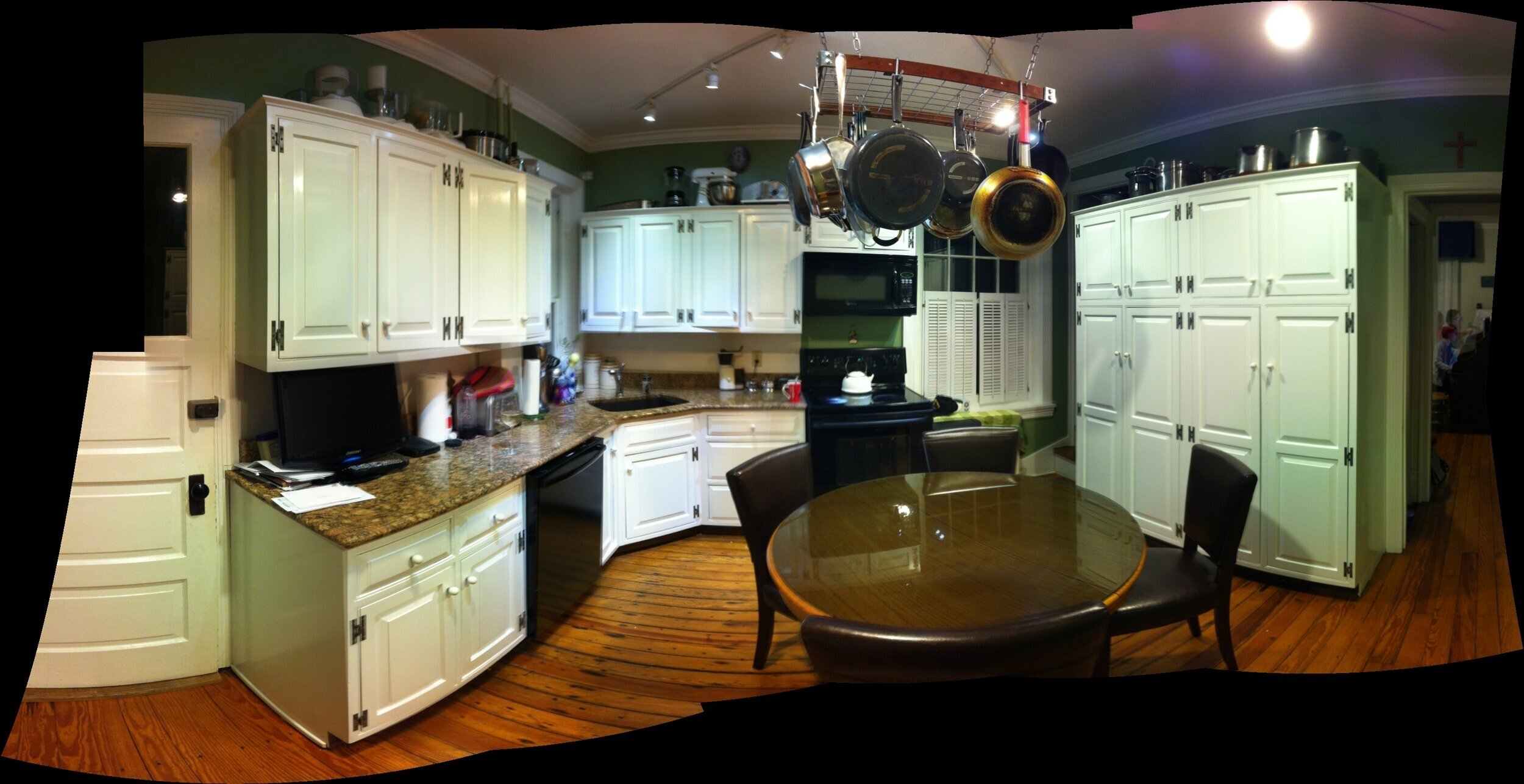 Here is a panorama of the original kitchen. The electric range was down to just one and a half burners! We recycled these cabinets by putting them in the new laundry room on the second floor.