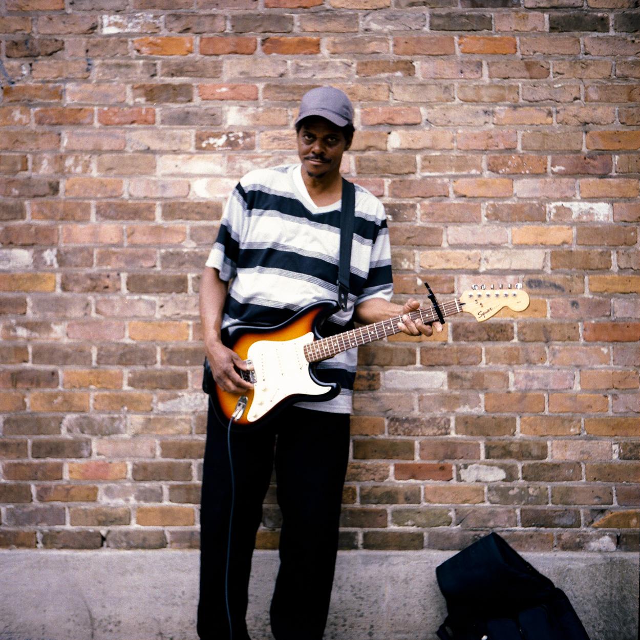 A local musician doin his thang on the Esplanade