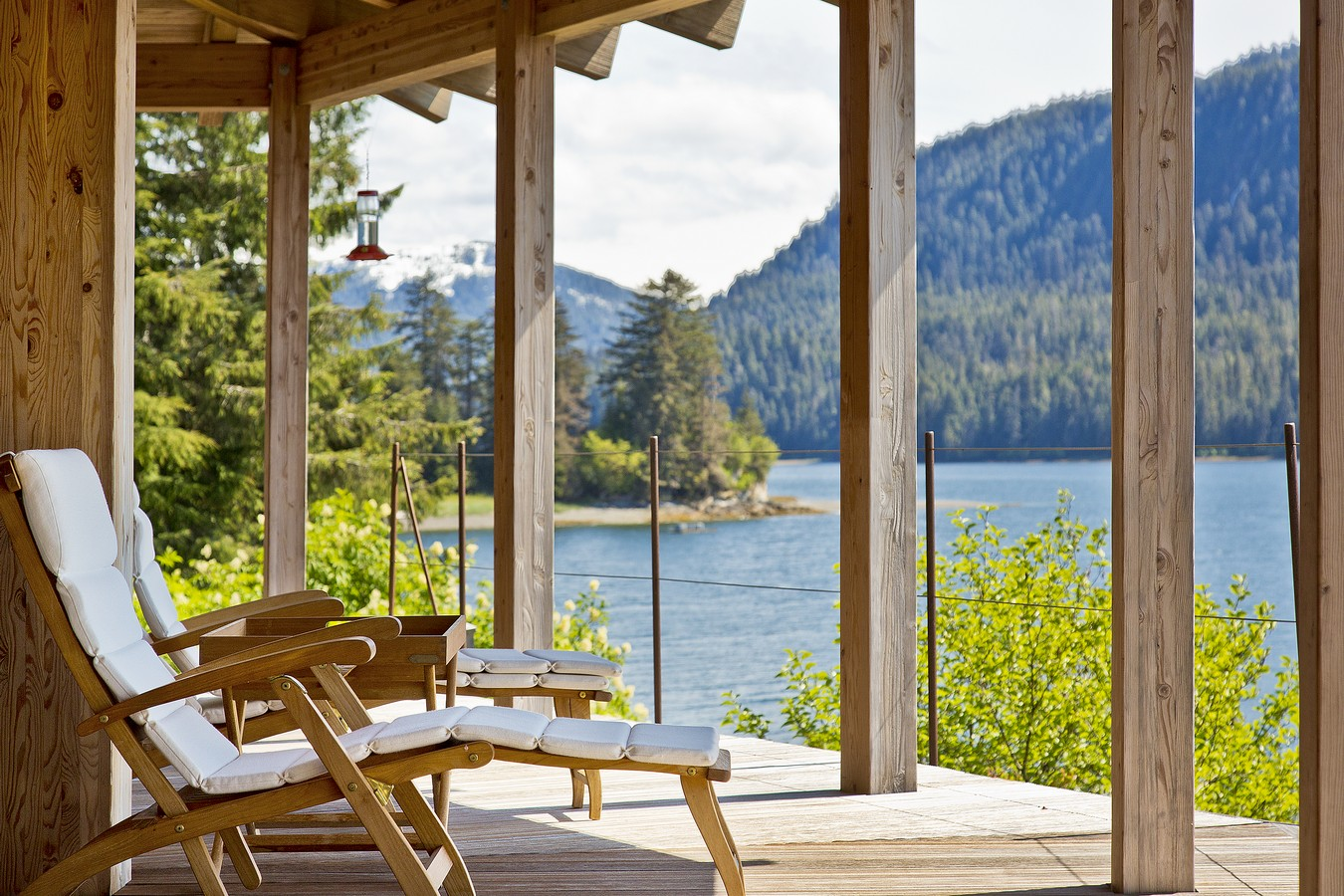 PICTURED ABOVE:   The outdoor living spaces at Hidden Bay Retreat include more than 2,000 sq. ft. of covered terraces with inspiring views of Hood Bay and the wildlife theater that is Southeast Alaska.