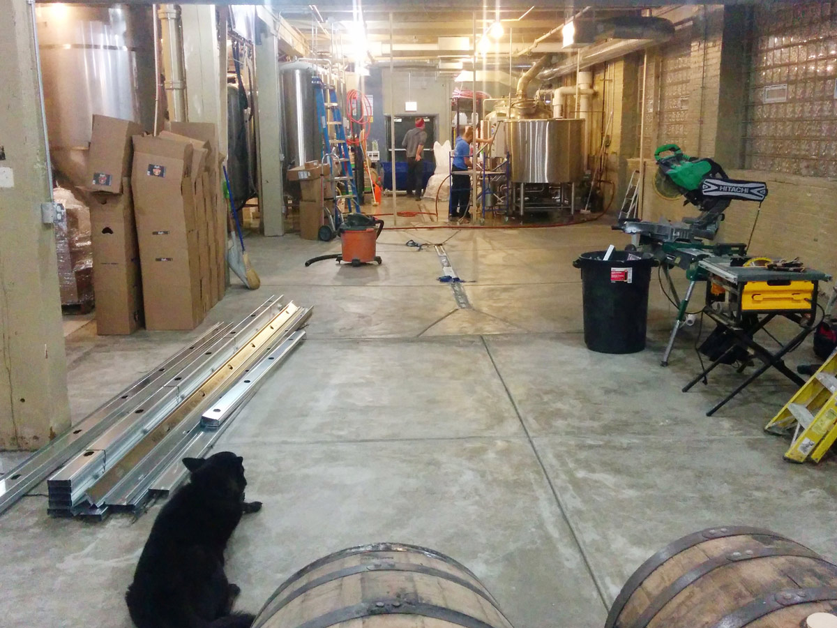 ... to a newly poured concrete floor. The newspace will be split with the back half housing new brewing equipment to allow for increased production.