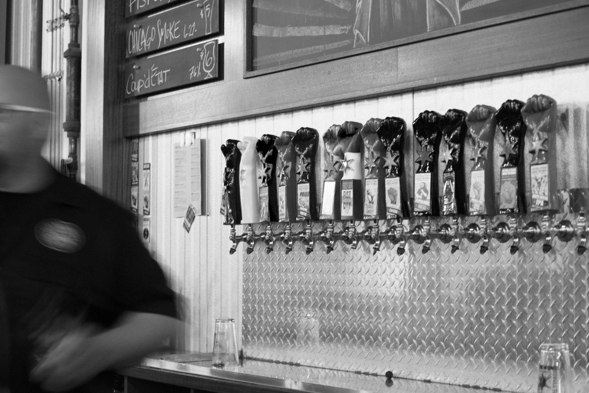 Justin Maynard slings pints at Revolution Brewing's taproom. [Photo: Robert Battista]
