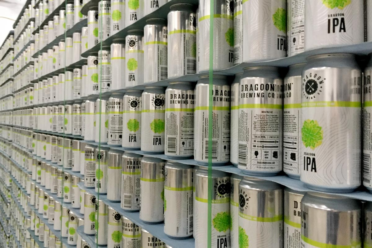 Cans at the ready, in Dragoon's new-ish 18,000 square-foot facility.