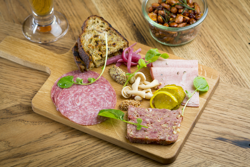 Charcuterie featuring daily selections of house made terrine and rilettes and locally sourced meats.