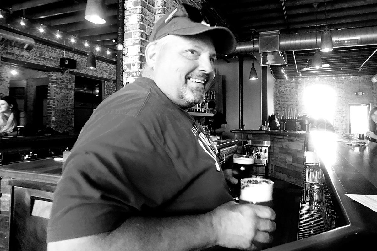 Brewer John Fahrer serves up pints in Omaha.