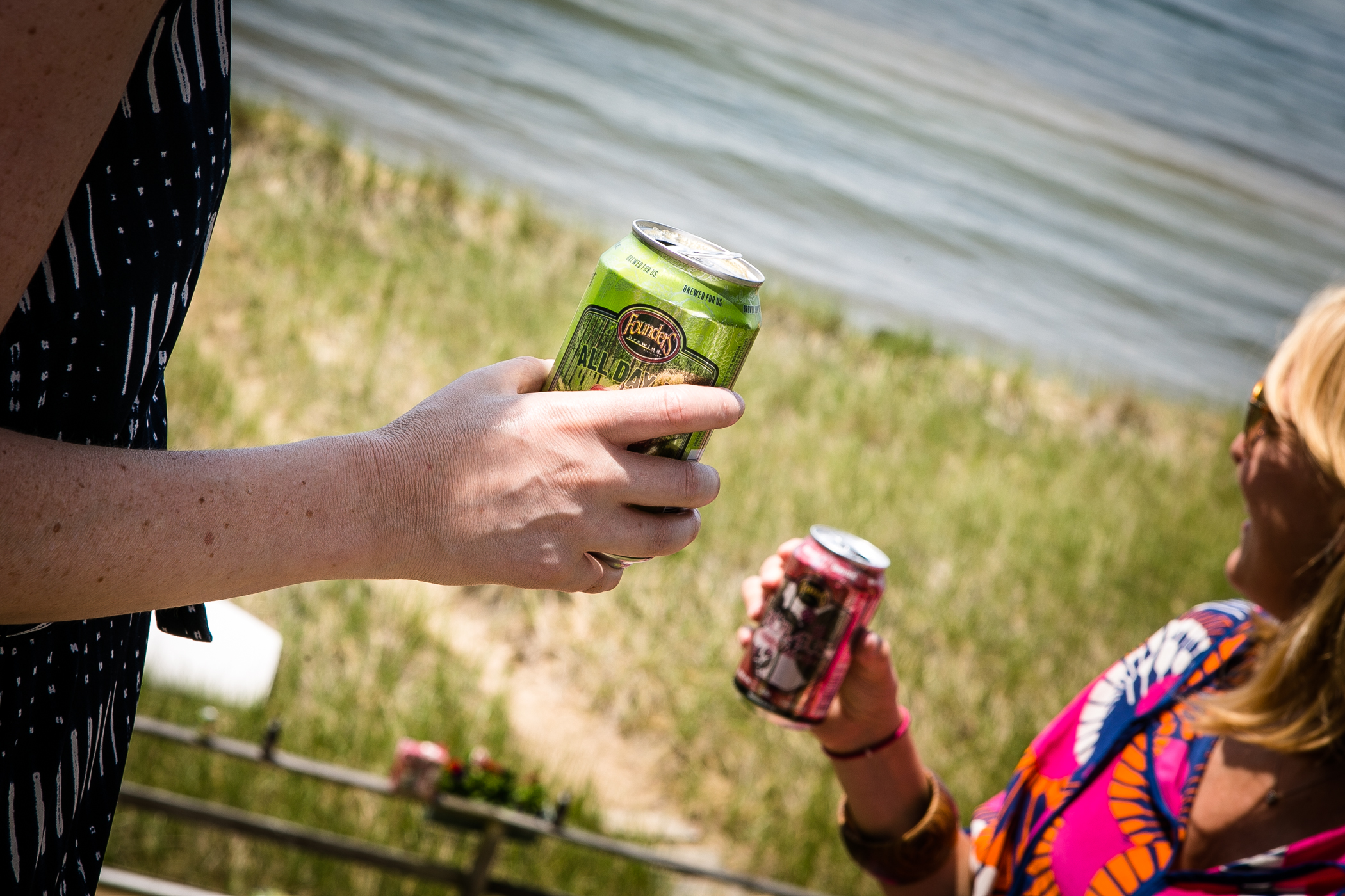 A couple of ladies take the day off to enjoy that summer Michigan weather with an All Day IPA (left) and the newly canned Rubaeus.