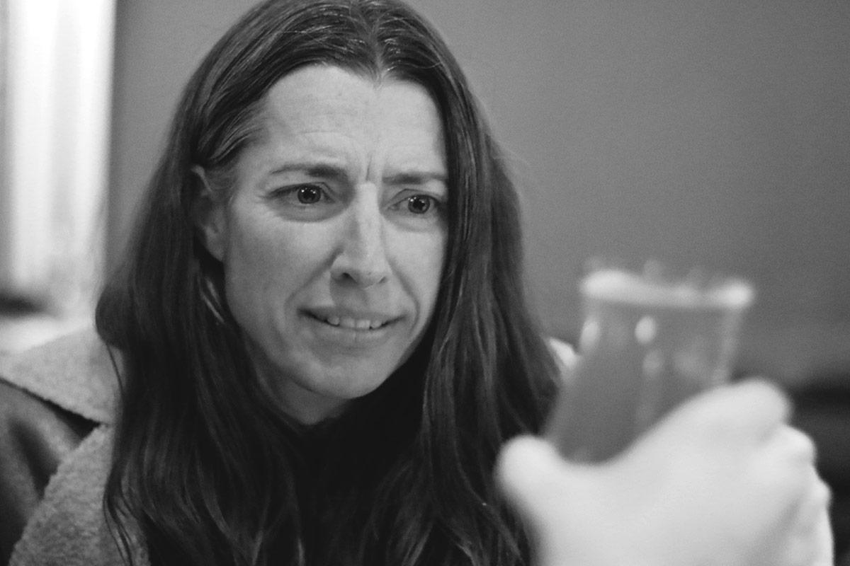 Lauren examines a beer at Kaiser Tiger.