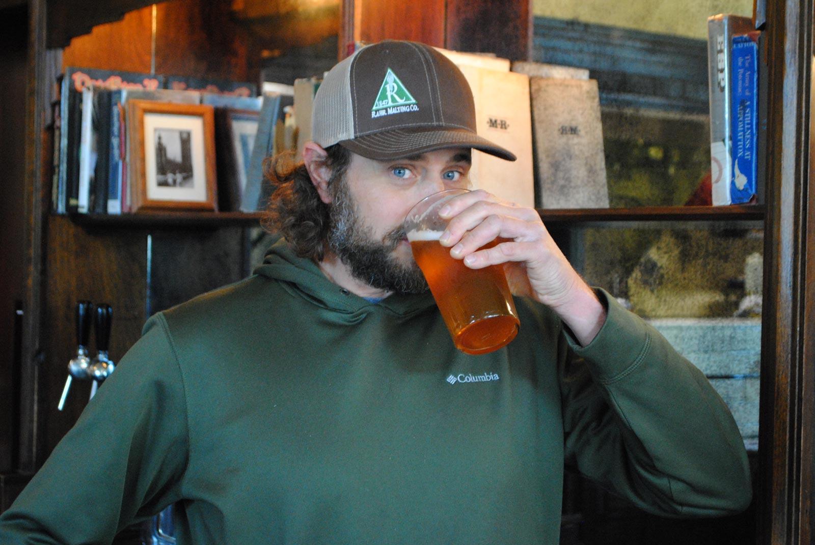 Head Brewer, Darren Cummings, enjoys a pint.
