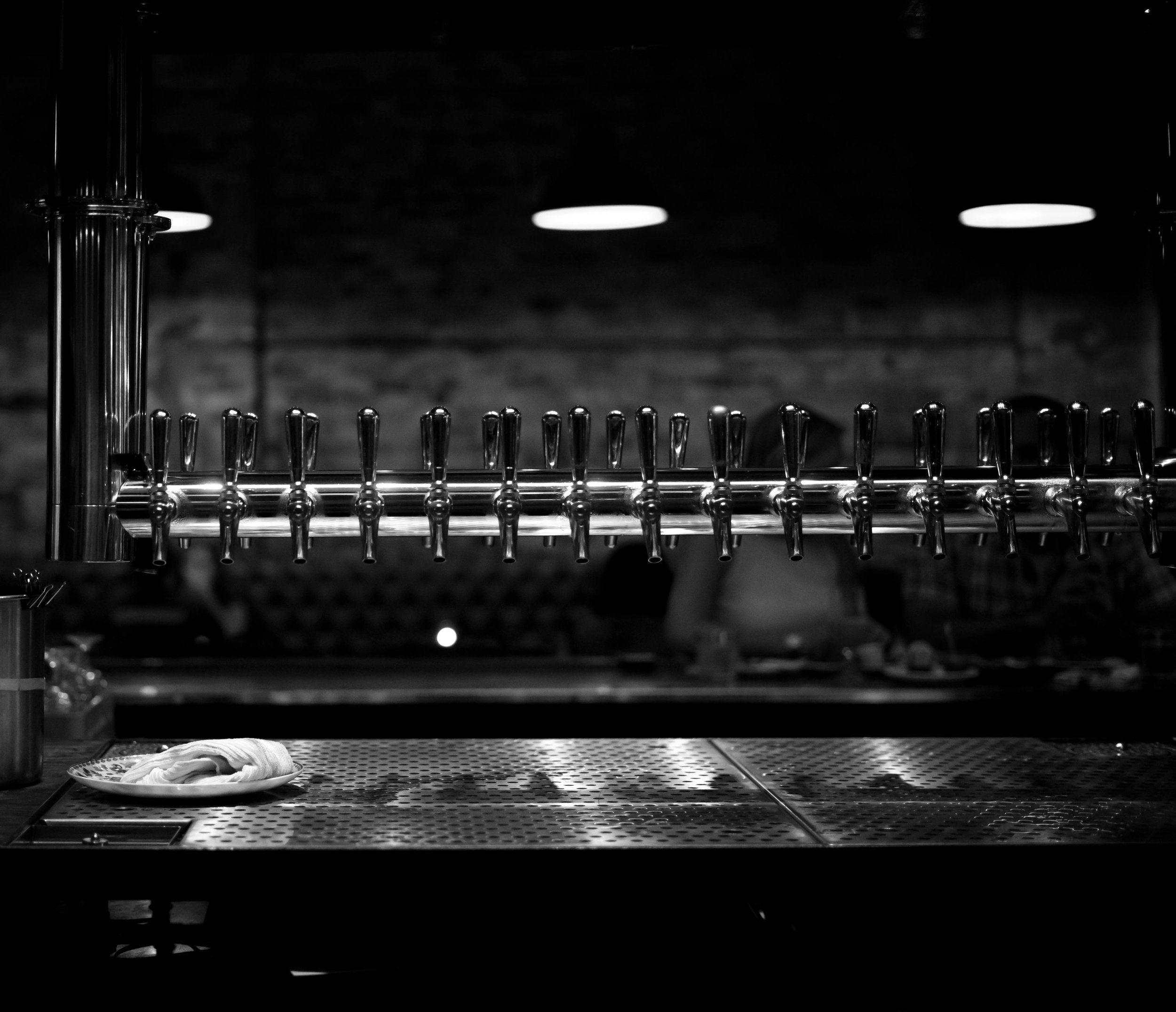 Taps sit idle and ready at the West Town brewpub on Chicago Avenue.