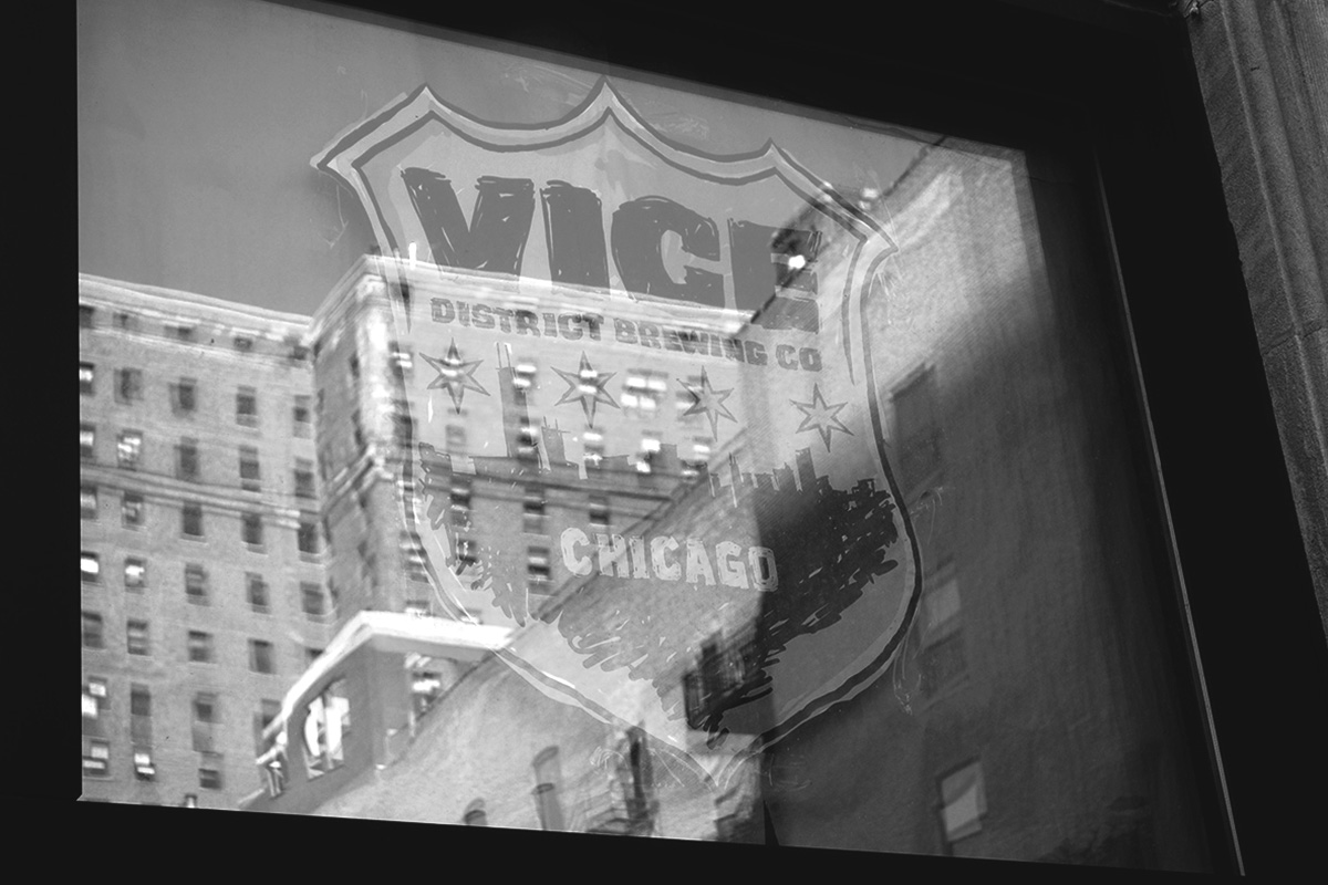 Reflection on taproom windows at Michigan Ave