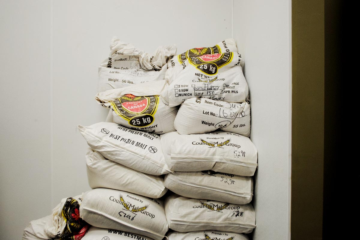 Bags of malt in the brewhouse at Tinley Park, Illinois' Tribes Brewing.