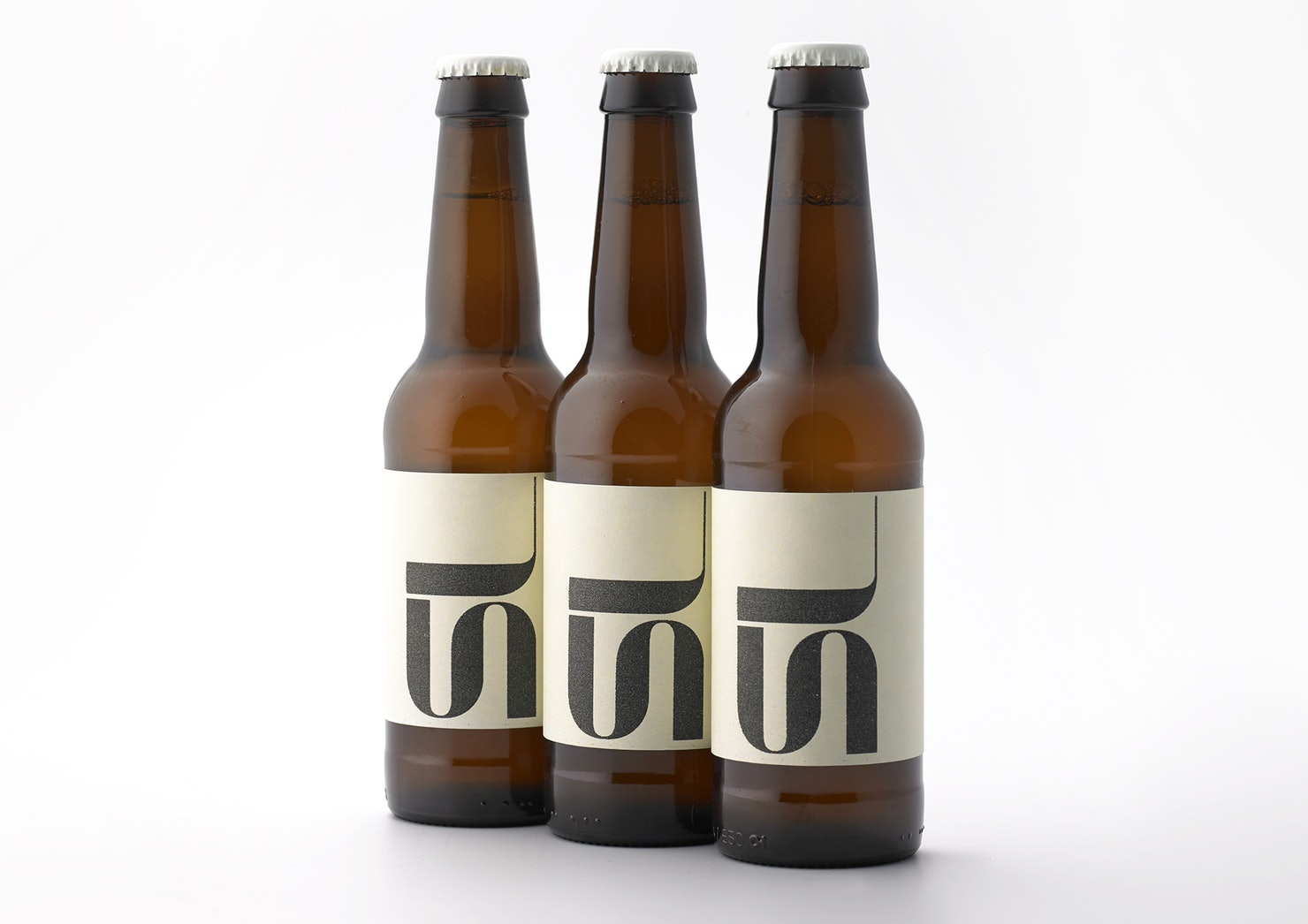 Above are two limited-edition beers created to celebrate Pentagram's two new partners: Sascha Lobe and Jon Marshall who joined the team during the rebrand.