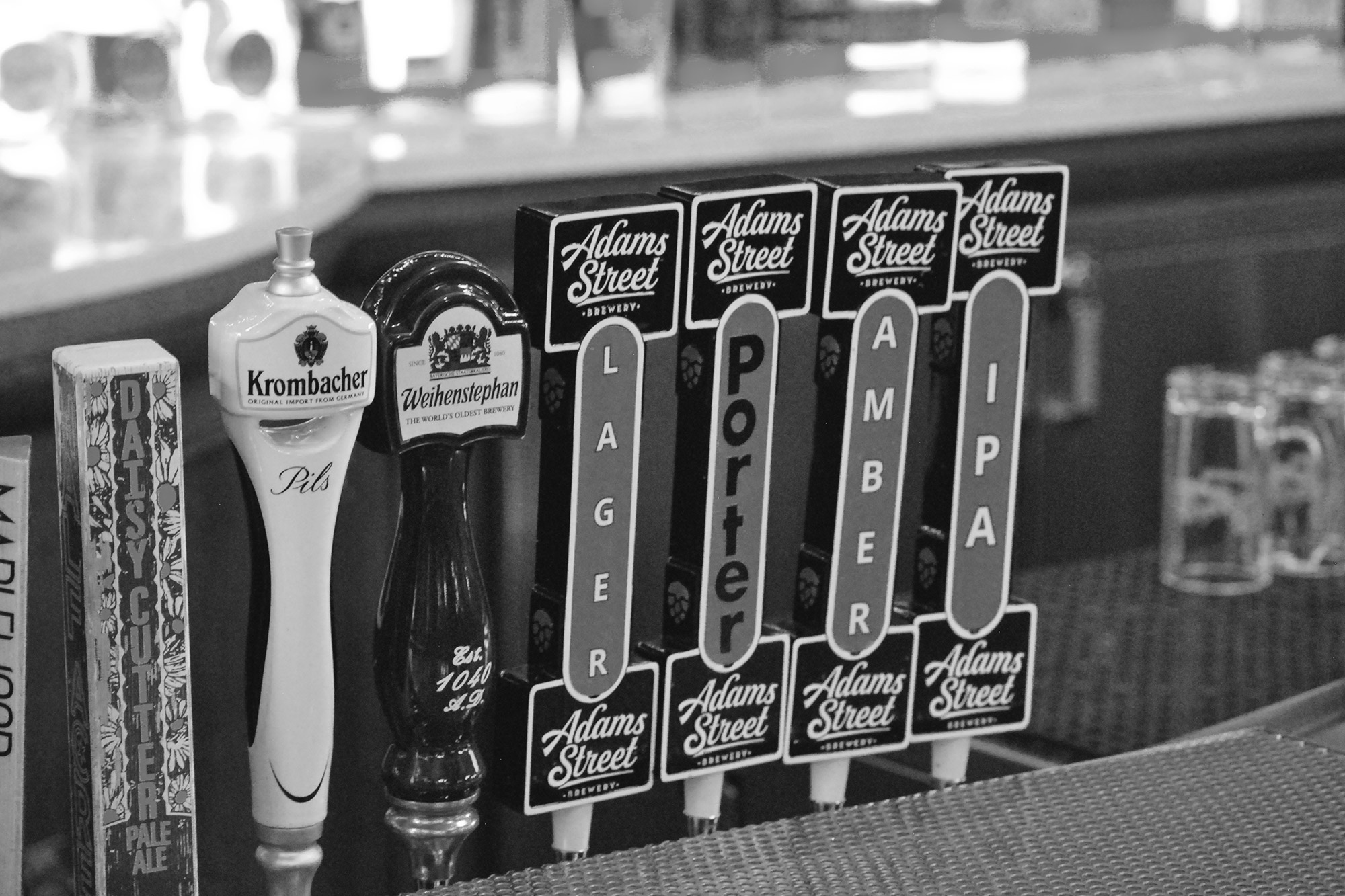 Initial Adams Street Brewery offerings sit alongside notable German and Chicago taps. The ASB tap handles mirror the shape of the iconic Berghoff sign.