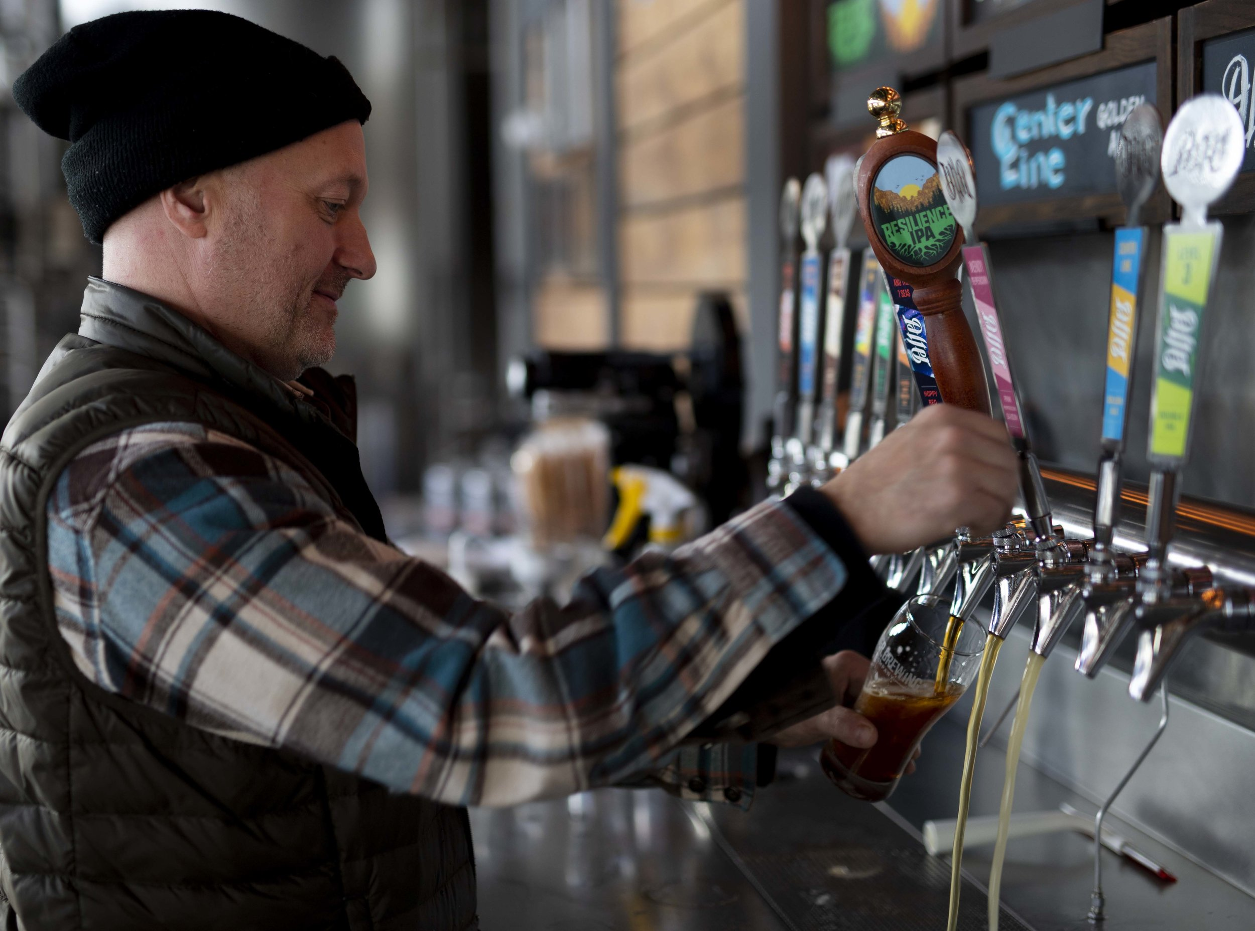 Co-founder Mark Hedrick pours a pint of  Resilience IPA.