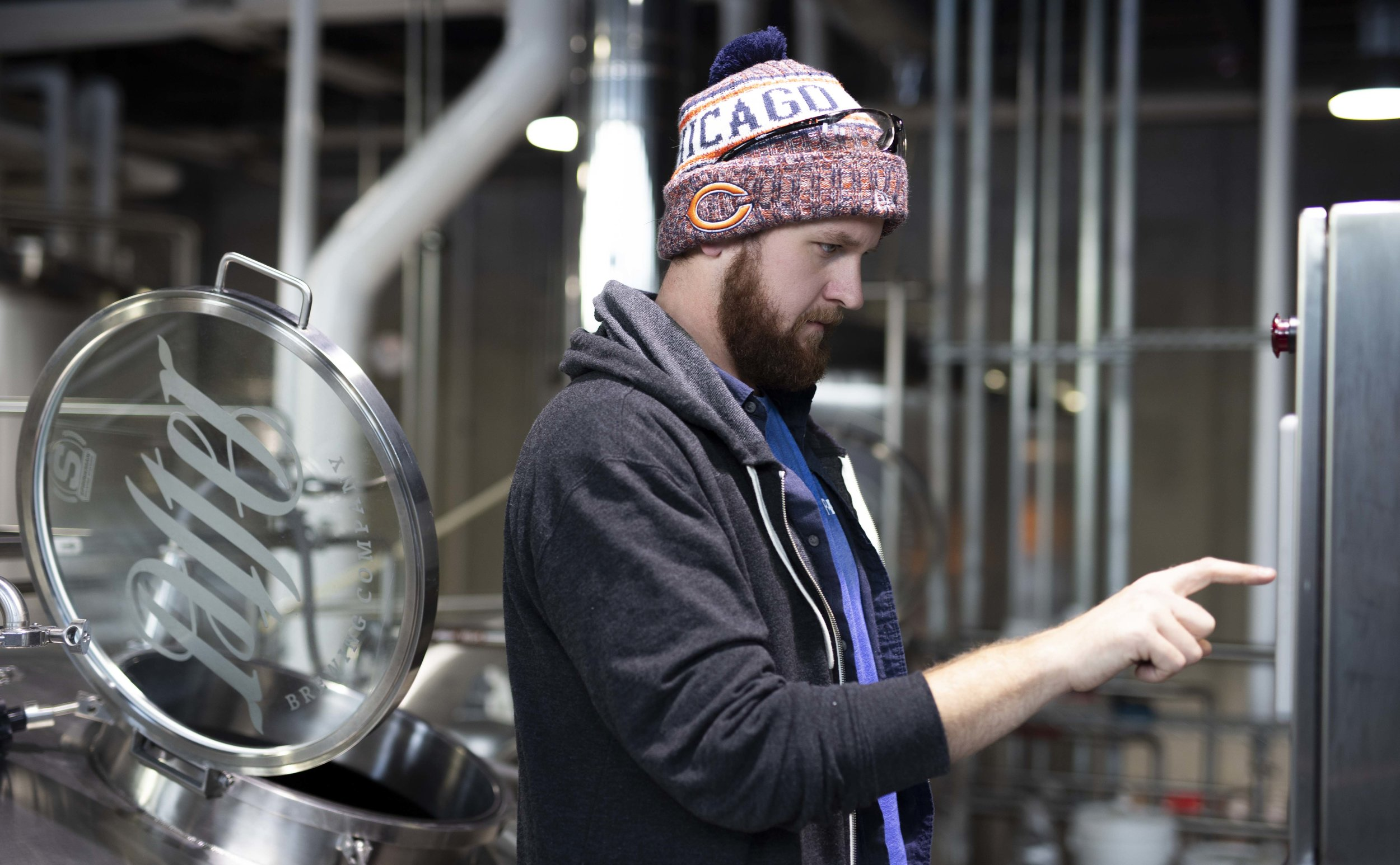Head Brewer Matt McCowan dials in a recipe in the brewhouse.