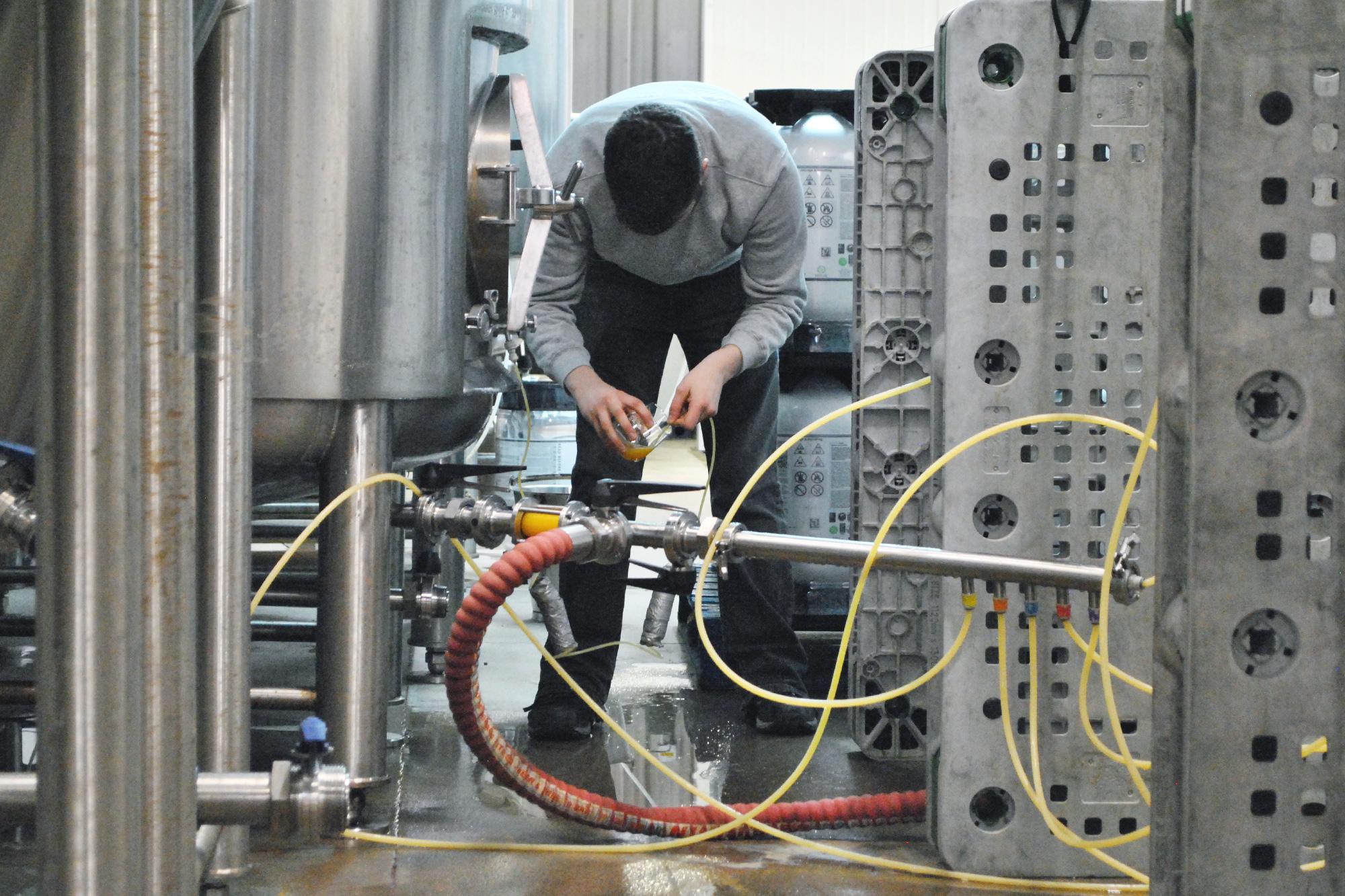 Head Brewer, Mat Breslin pours some fresh  Octopod  milkshake IPA.