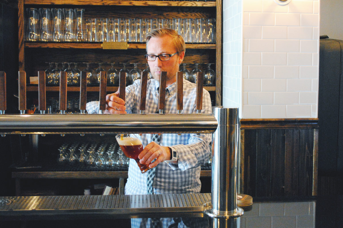 Owner Paul Leamon pours a pint in 2015.