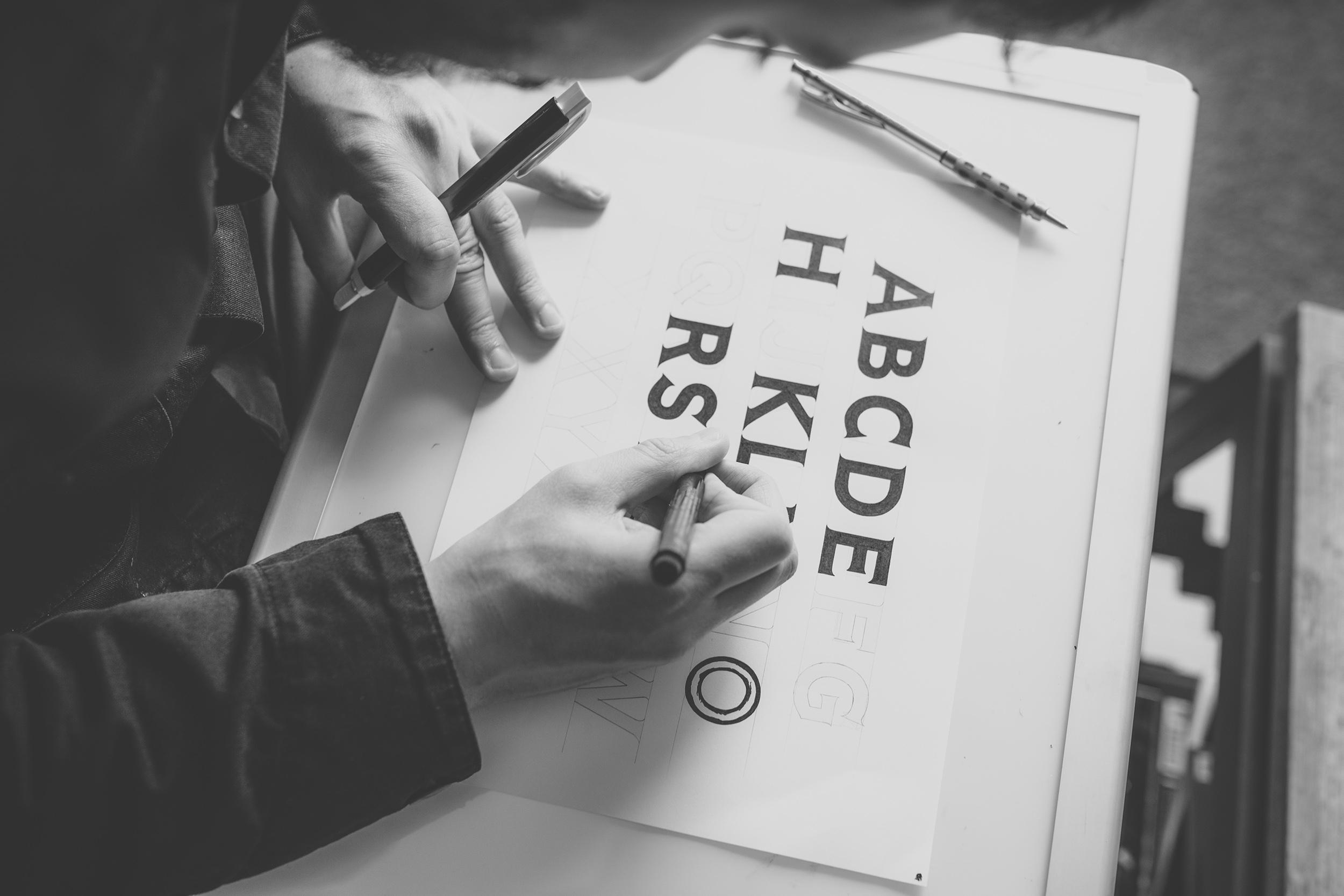 Custom typography process & implementation.