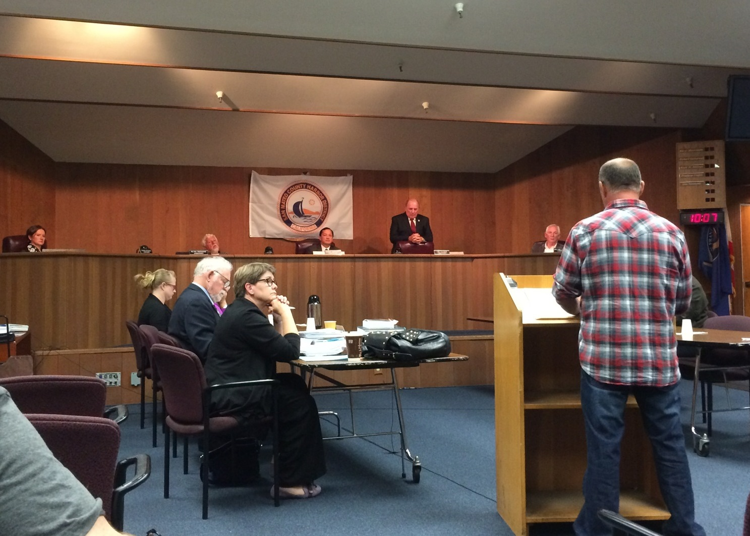 Commercial Fishermen Steve Fitz standing at the podium in South San Francisco