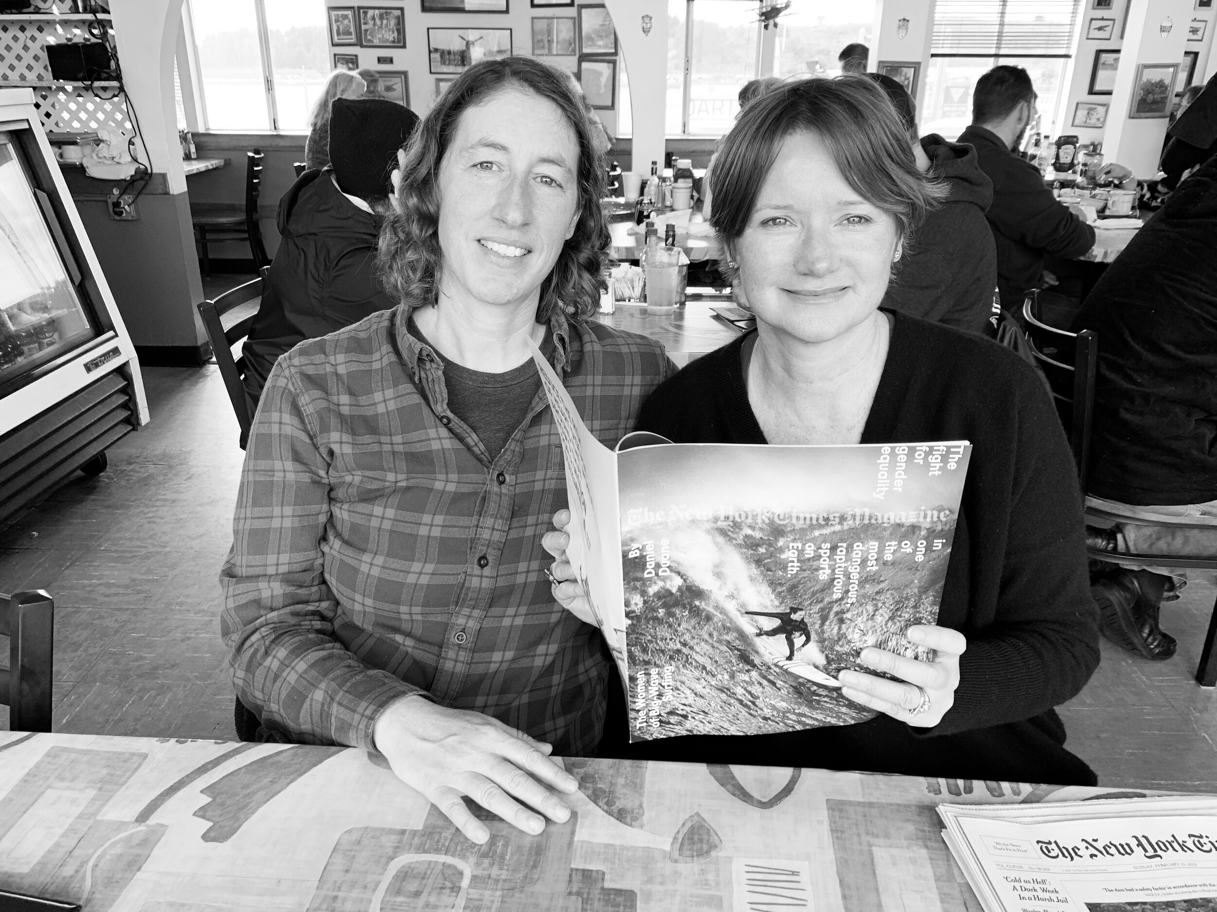 Aimee Luthringer & Sabrina Brennan reading the New York Times Mag at 3-Zero Cafe in Moss Beach, CA