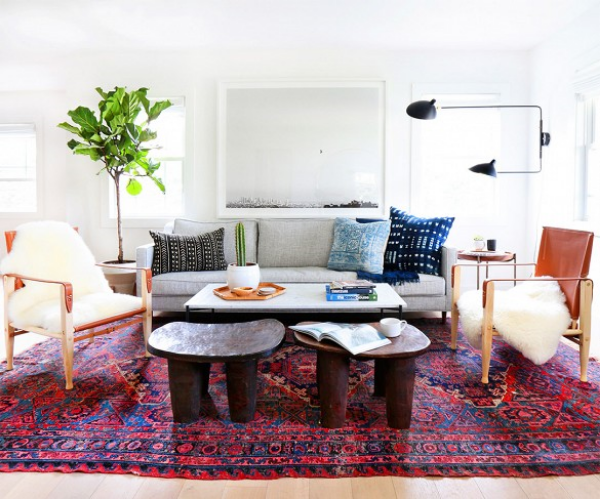 Image: Domain Home     This larger space had room for a few extra stools, which is always fun!The sofa looks dwarfed by the size of the chairs and chunky stools.