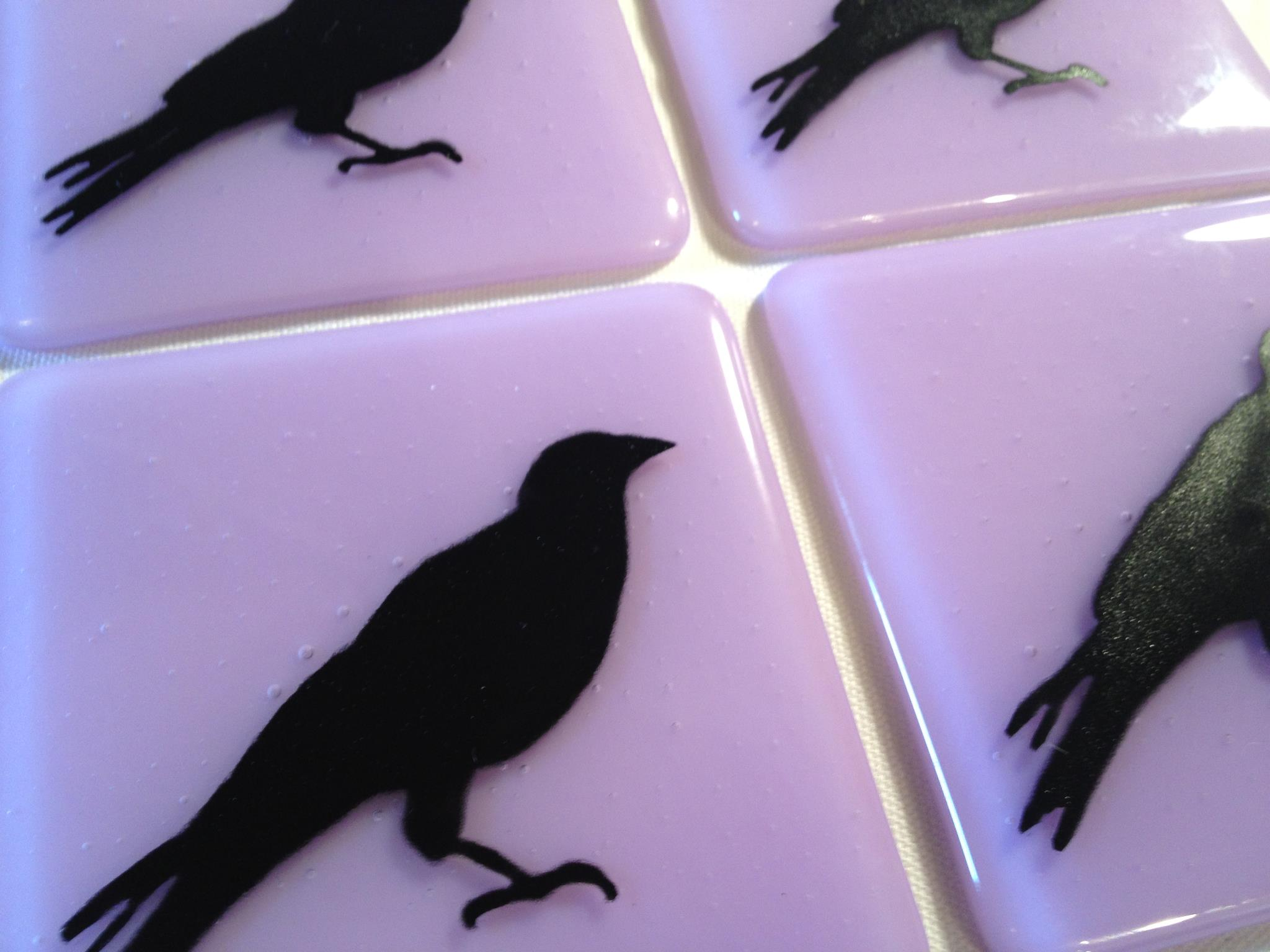 Hand-painted crows fused into lavender glass tiles.