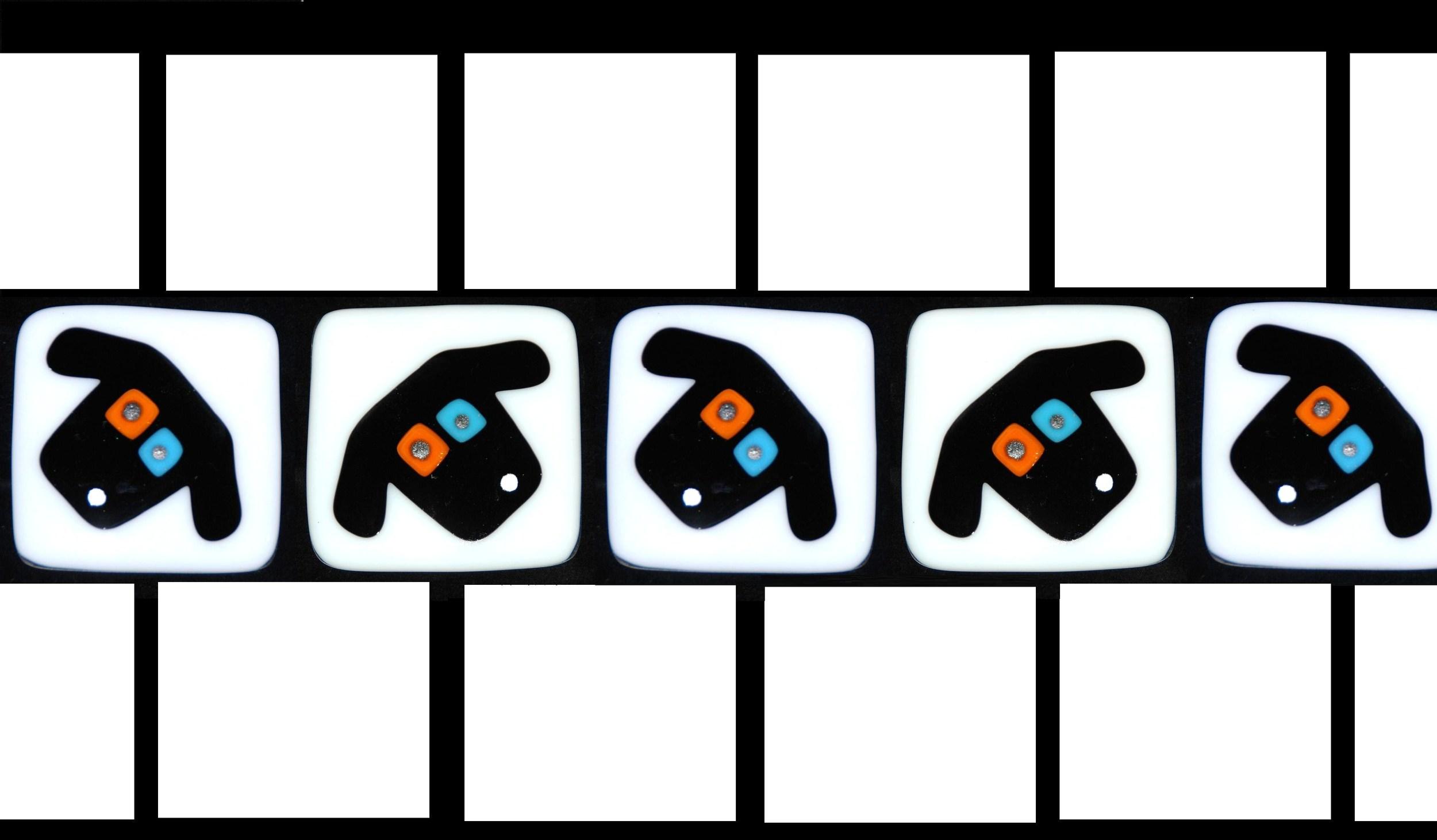 row of black dog faces on white.jpg