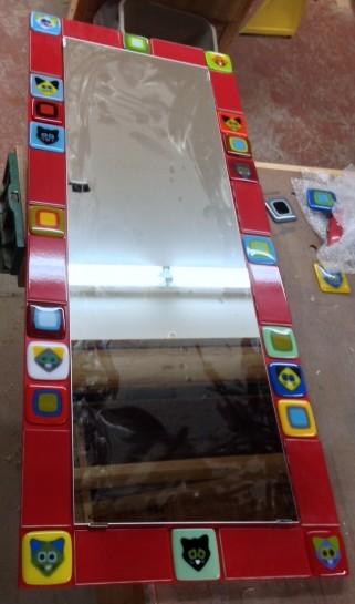 cat tiles and craftsman tiles around mirror.JPG
