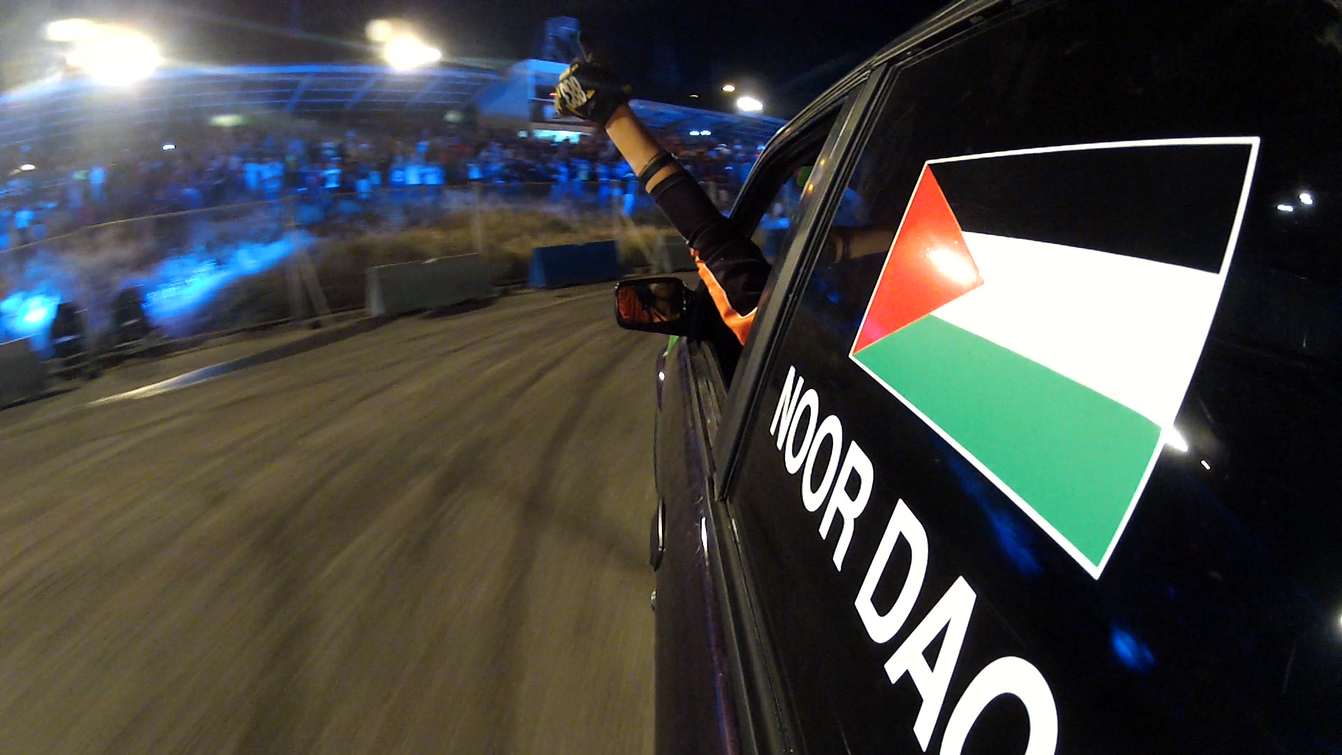 05 Noor gives a thumbs up as she completes a drift course in Jordan  - Credit Amber Fares.png