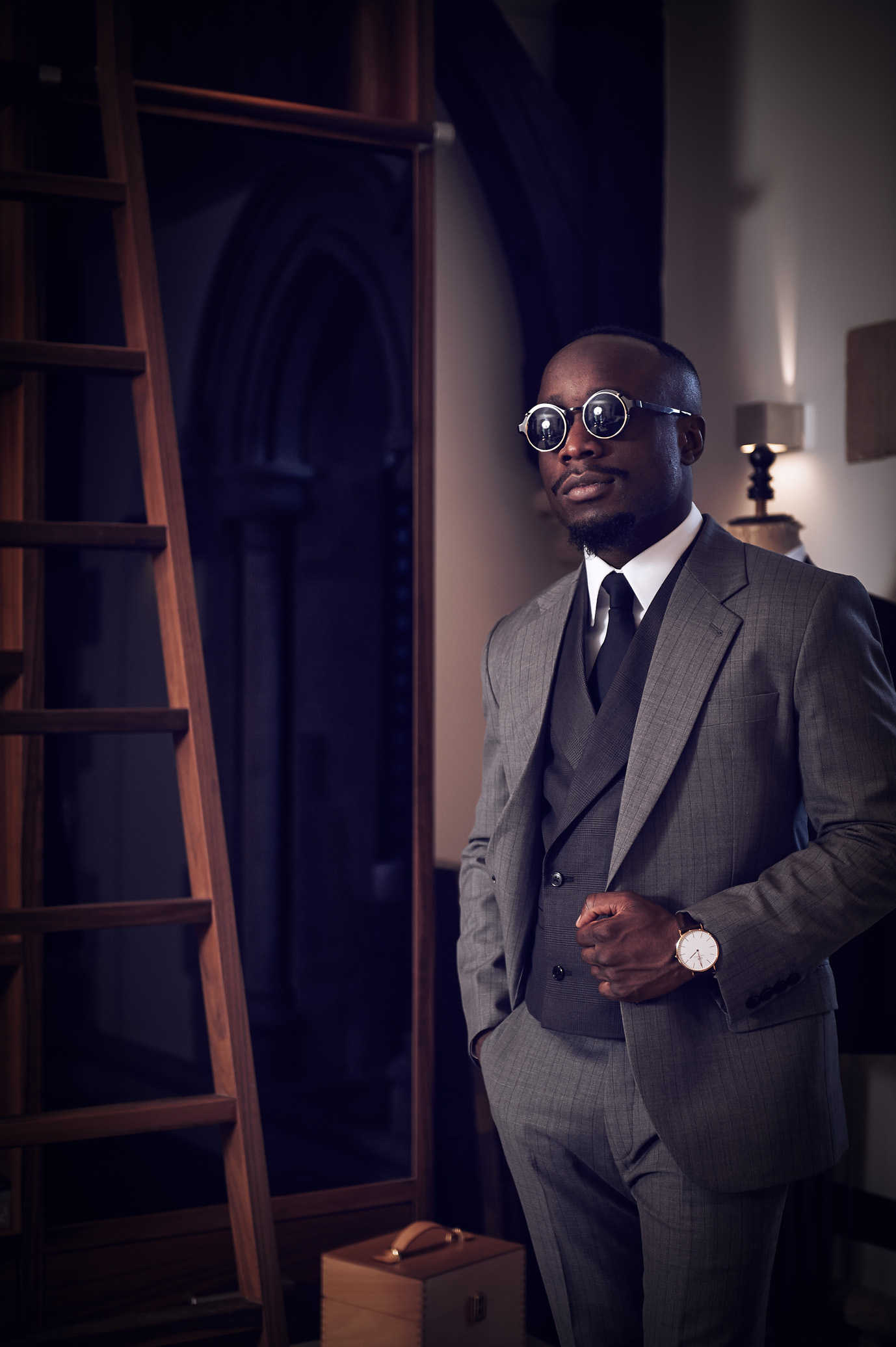 Advertising fashion photography shot of a man weraing a grey suitfor a bespoke taylors, specialising in hand made suits