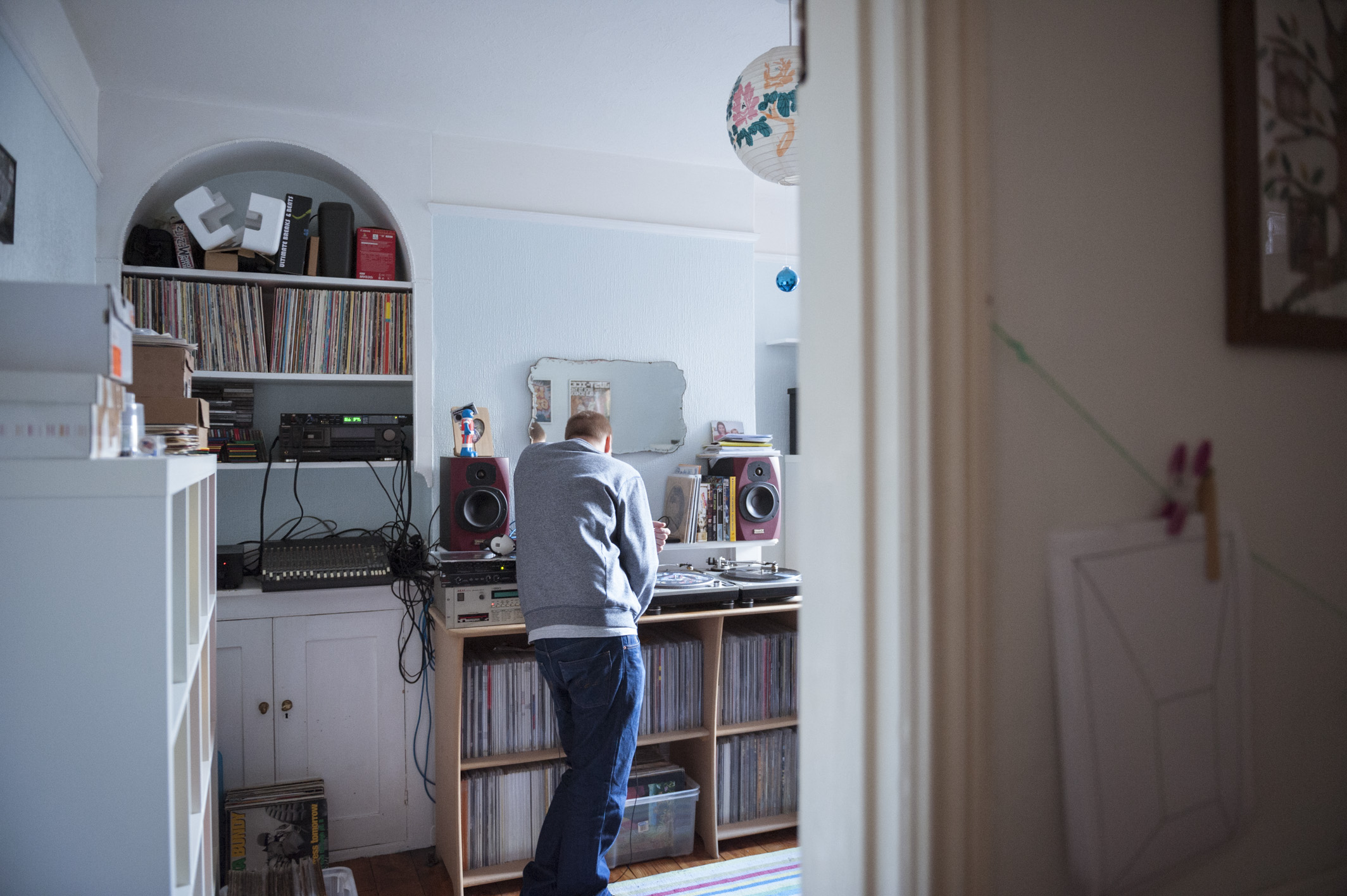 UK Hip hop music producer photographed in his home music studio for a documentary project