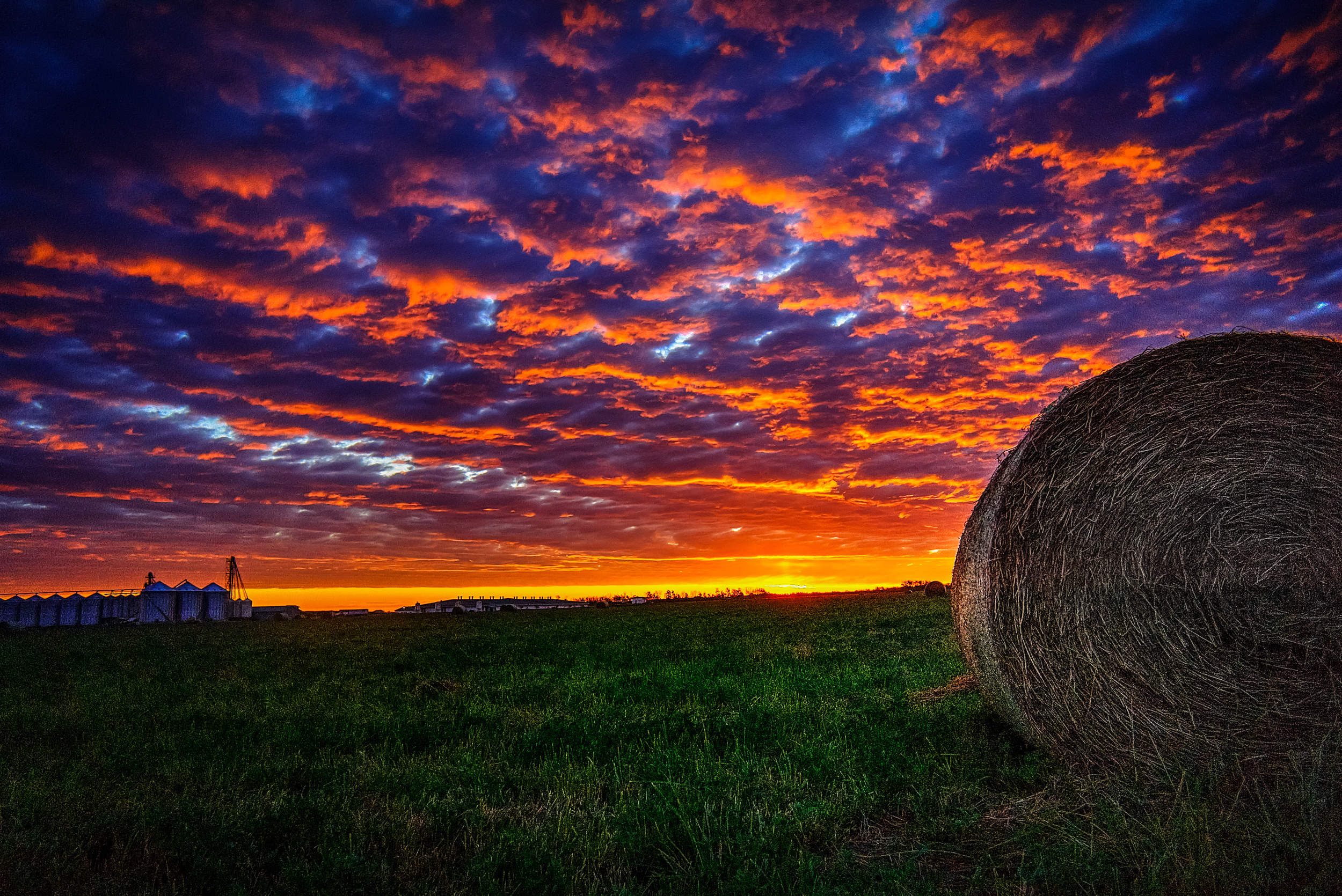 sunrise hay roll field.jpg