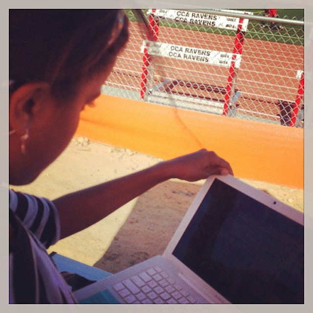 One girl studies on the field while the other competes! #studyhard #athletes