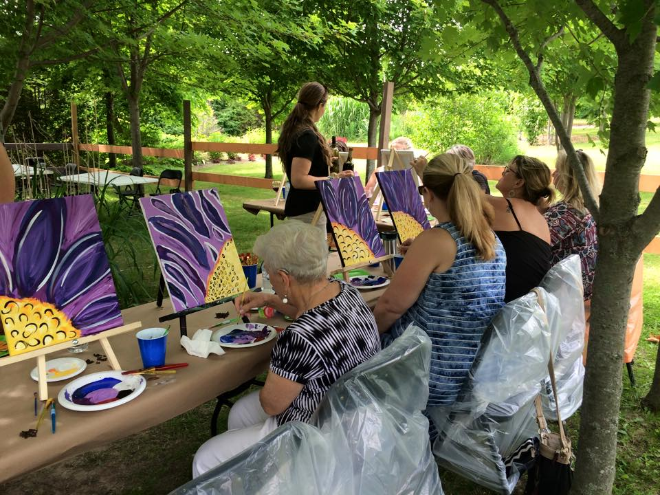 folks painting purple flowers.jpg