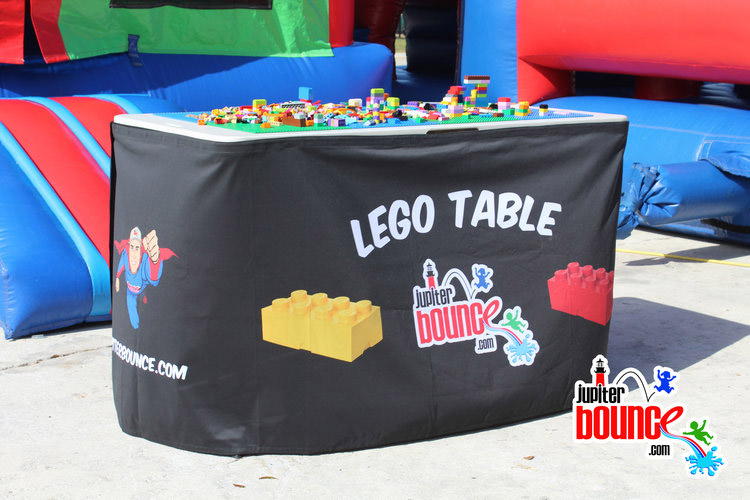 legotable-jupiterbounce-stuart-hobesoundpartyrental-partyplanning-bouncehouse-waterslide-photobooth.jpg