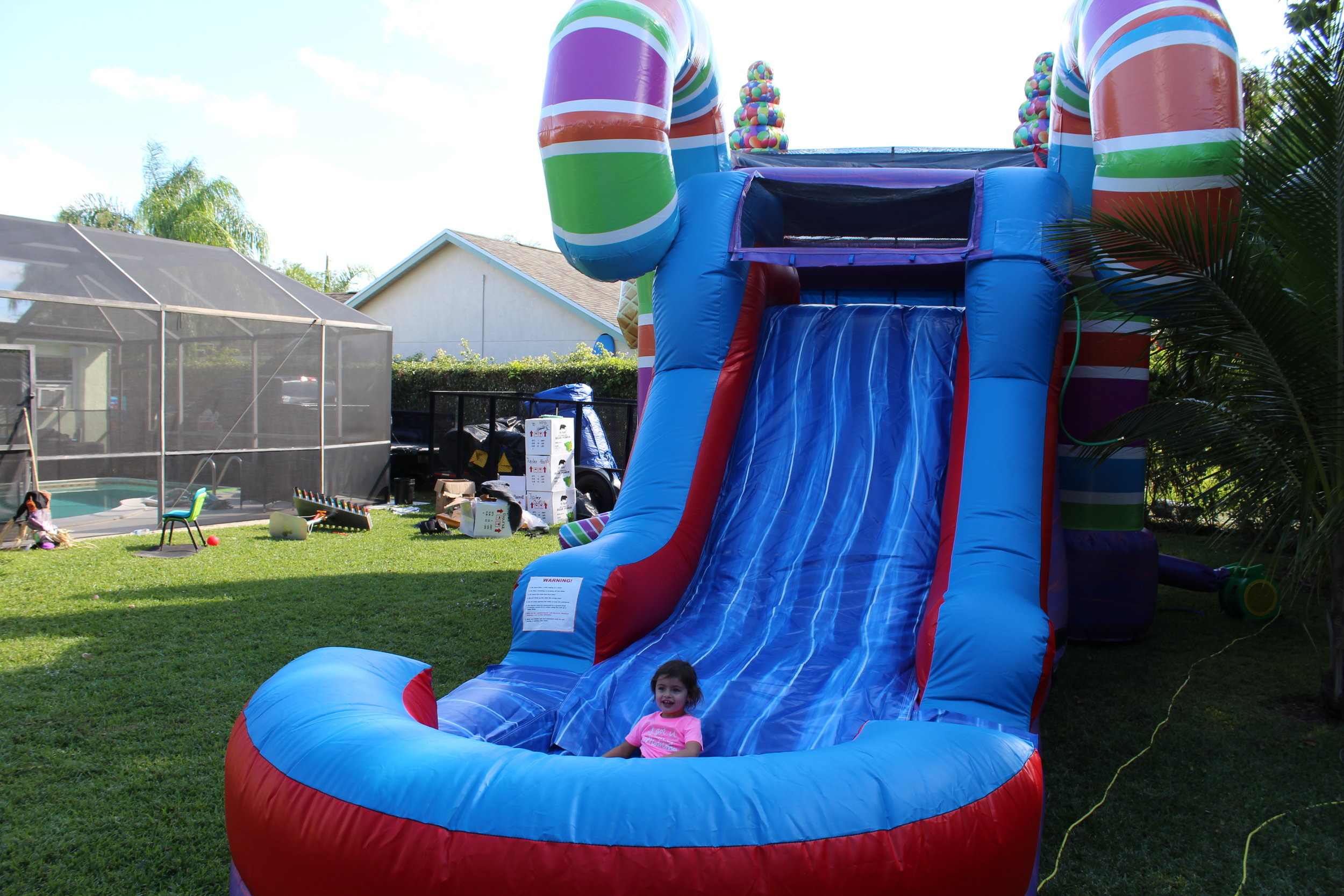 sugarshack-candylandthemedunit-bouncehouse-waterslide-icecreamsocial-photobooth-rockwall.jpg