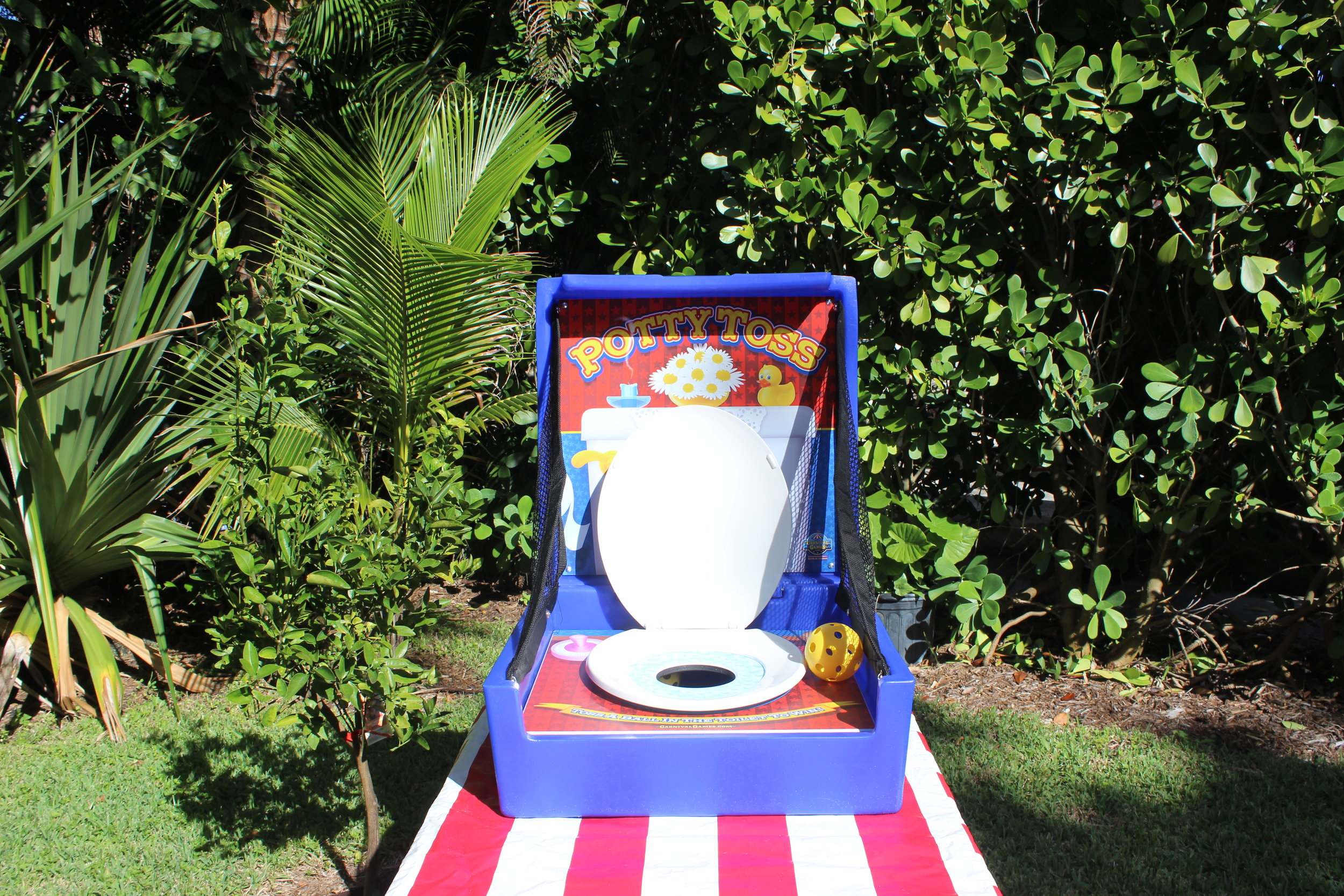 pottytoss-jupiterbouncehouse-waterslide-carnivalgames-circus-photobooth-mechanicalbull.jpg