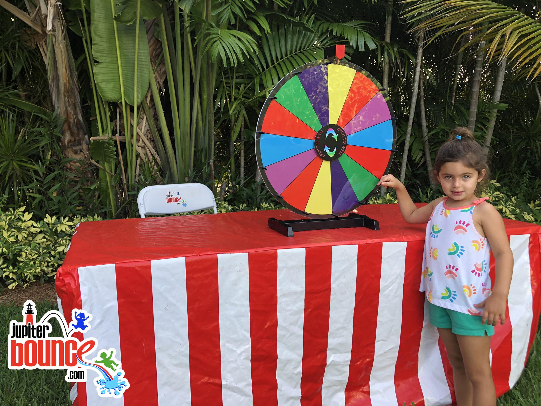 prizewheel-jupiterbouncehouserental-palmbeachgardens-loxahatchee-wellington-stuart-rockwallrental-photobooth.jpg