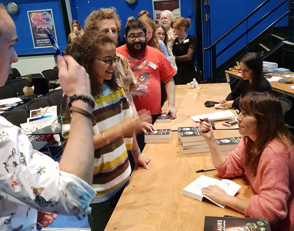 Lucy Cooke (at right) signs copies of  The Unexpected Truth About Animals . Image: Darren Naish.